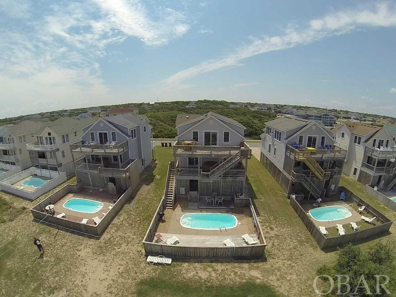 This 4 bedroom, 3 1/2 bath home is only 2 lots from the ocean and has incredible ocean views! Features include a private pool, hot tub, game room with tiki bar and pool table, 2 master suites with ocean views , gas fireplace and over $55,000 in seasonal rental income. The rental website is http://www.obxbreakers.com/. VRBO website - https://www.vrbo.com/286188  In the past 2 years the following updates were made: *Refrigerator  *Surround sound in ceiling *Refrigerator and hot water heater  *Thermostats  *pool pump *Hot tub control center/mother board and new ground wire and cover *New deck furniture  *Poolside deck *New lights exterior  *New roof on north side of house,  3tab 150 mph shingles  *New Stainmaster plush cut pile carpet throughout  *Custom paint *Comforters *New flat screen tv's throughout  *New grill .