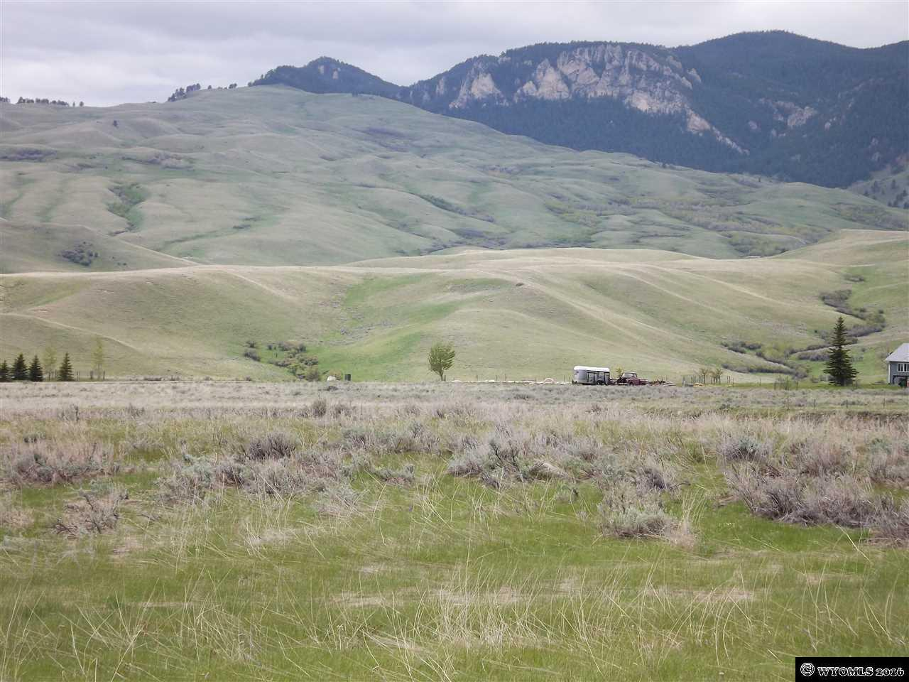 Beautiful 5 acres, with view of Lake Desmet and the Big Horn Mountians! Great building spots and plenty of pasture for your horse or cow. Good access with end of the road location. This is a great price too! See documents for map. Survey pins have been located and marked with pink tape.