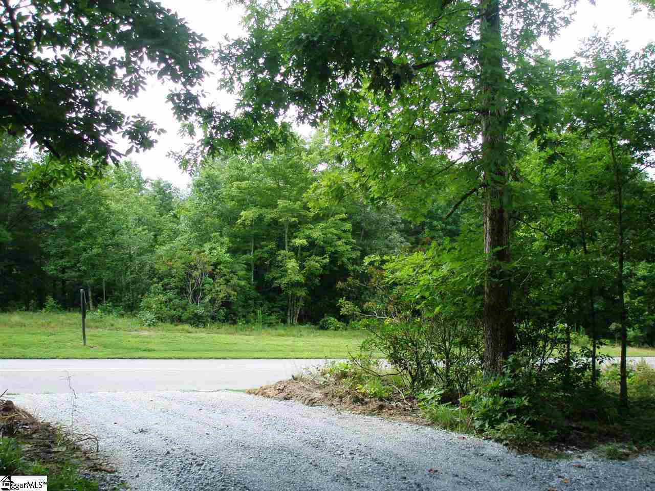 This lovely, wooded .93-acre homesite offers an easy build site, beautiful mountain laurel and hardwoods as well as seasonal mountain views. A full Golf Membership is available and must be purchased with the property.