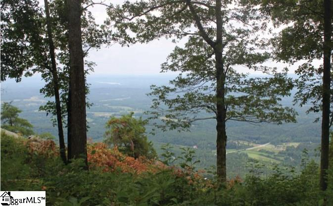 This fantastic high elevation homesite offers you the unique ability to enjoy long range views of the Upstate's piedmont plains and Blue Ridge Mountains from a relatively level build site! Enjoy cool breezes in summer and awe-inspiring views all season. This lot on Rose Pink Trail is also located within walking distance to the golf course, clubhouse, and Sunset Pavilion. A Cliffs Club Full Golf membership is available and must be purchased with the property.