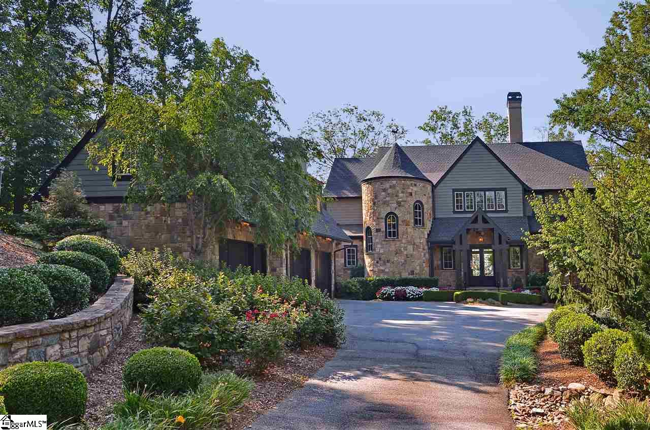 Nestled in the mountains just minutes from Greenville, SC, make yourself at home in the comfort and convenience of The Cliffs Valley gated golf and wellness community.  This elegantly crafted home was custom designed and built by well-known Stephen Fuller Designs.  The minute you step through the front door, stunning long range views to the south take your breath away.   Versatile outdoor space including screened porch with fireplace and an expansive deck across the back of the home offers multiple options for enjoying that view.  Inside, you will find graciously proportioned rooms that are warm and inviting.  This home has comfortable yet classic styling with great room, gourmet kitchen with hearth area, dining area, master suite and laundry on the main level.  Upstairs, you will find 3 guest bedrooms and 2 guest baths.  The lower level walk out features great entertaining space with an inviting full bar area adjoining a comfortable TV viewing space.  A separate room currently being used as an office could alternatively be used as a bedroom.  The lower level also has ample unfinished storage space.  Additional unfinished space can be found above the 3-car garage where stairs take you to what could be finished as a hobby room or workshop. Around the home, the owner has accented the architecture and mountain setting with beautiful landscaping.  The result is a home with wonderful curb appeal.  A Cliffs Club membership is available to purchase with the real estate.