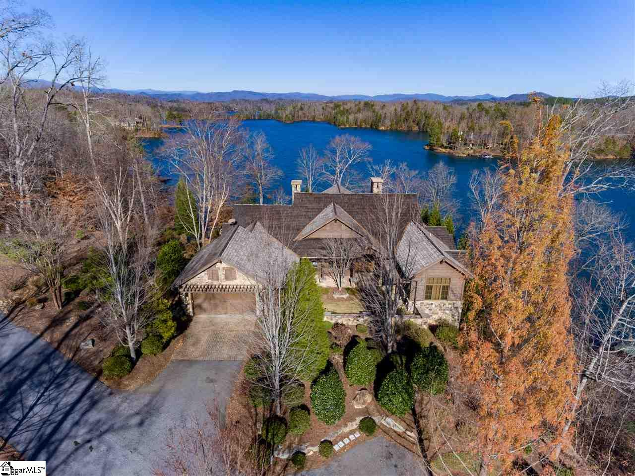 Check out this Exclusive Luxury Water Front Estate on Beautiful Lake Keowee. The setting is one of the finest available on Lake Keowee showcasing expansive lake and mountain views. Bring your boat to this awesome Home as it includes a covered boat dock with a lift. A stone fireplace anchors one end of the spacious great room, with the other open to the kitchen area. This home features a bunk room which will sleep 8! Hurry and call today to schedule your private showing of this incredible home! Don't miss out on this amazing opportunity on Lake Keowee! Cliffs Membership is available with access fee. Additional HOA for Falls Creek Section of Cliffs Falls South: $1,750 per quarter covering painting/staining of homes every 3 years, gutter cleaning, front yard landscape upkeep and mulching, vacant lots maintained. All measurements and numerical representations to be verified by the Buyer and/or Buyer's agent if this information is important to the purchase decision.