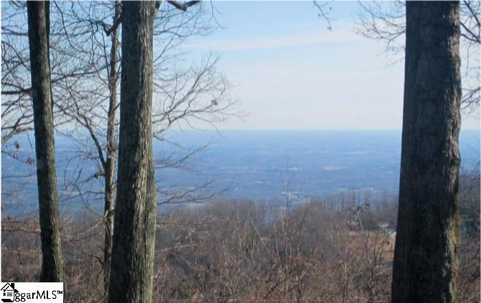 Enjoy a top of the mountain feel on this 1.51-acre homesite boasting magnificent long-range views of Greer and Spartanburg, the golf course and clubhouse. Scenic rock outcrops, hardwoods and rhododendron enhance this very private, end of cul-de-sac location. A Cliffs Club membership is available but not necessary to own this beautiful homesite!!