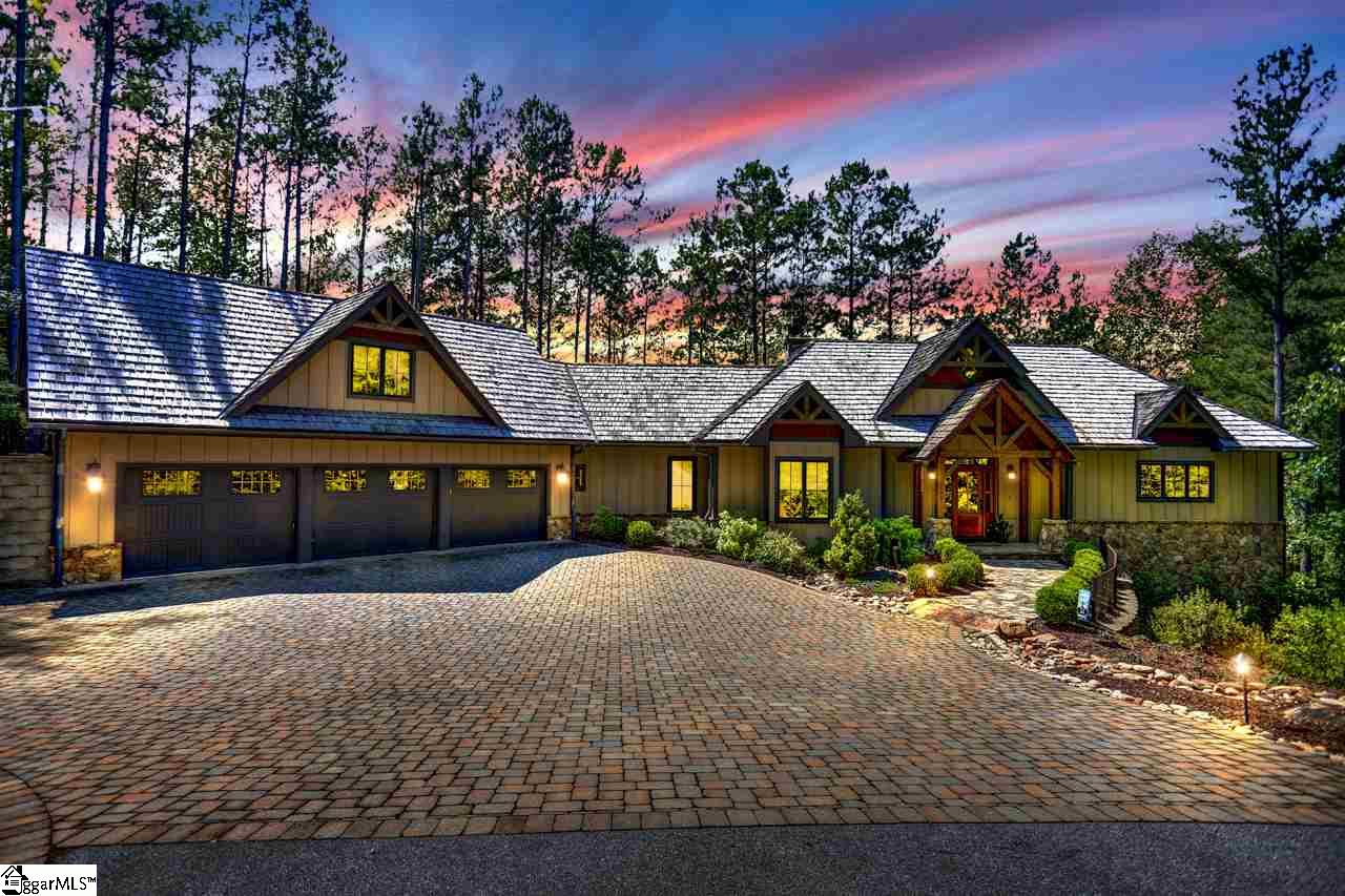 "**Post & Beam, Golf Front Masterpiece** being offered at $100K below last appraisal. This home at ""The Reserve at Lake Keowee"" has it ALL! The 5BR/5.5BA basement home has a view to die for and is PRICED TO SELL. The custom craftsmanship is on display the moment you roll down the custom paver driveway to see the lush, well maintained grounds and Rustic styling. As you stroll down the Flagstone sidewalk, passed the soothing water feature, you enter to the Soaring Post & Beam interior by ""Mill Creek"" one of the most revered artisans of this style of living. This OPEN FLOOR PLAN is built for entertaining with its Enormous Dining & Great Room, Stacked Stone Fireplace and ""Wall Of Windows"" that offer amazing views of the 2nd Hole at this World Class Golf Course! The gourmet kitchen has 6 Burner Jenn Air Gas Stove, Granite Countertops, with Large Eat Up Island, Stainless Appliances, Walk In Pantry. and of course a Farmhouse Sink! A large Master Suite, Guest Suite and Walk in Laundry Room round out the Main Level. An Additional Guest Suite/Bonus Room with Full bath, above 3 Car Garage, is waiting to become a play room, Man Cave or just a quiet getaway. Downstairs you will enjoy the 39x17 Entertainment Area with another Stacked Stone Fireplace, Wet Bar, Two Additional Guest Suites with Full Baths, Small Garage for your Golf Cart and LOADS of Storage! Add the Screened Porch with Fireplace, Huge Hot Tub tucked privately in the perfect spot, the 58x17 Deck overlooking the grounds, Firepit and Golf Course makes this outdoor living just as spectacular as inside! Simply a place you will want to call home, whether full time or just on the weekends!"