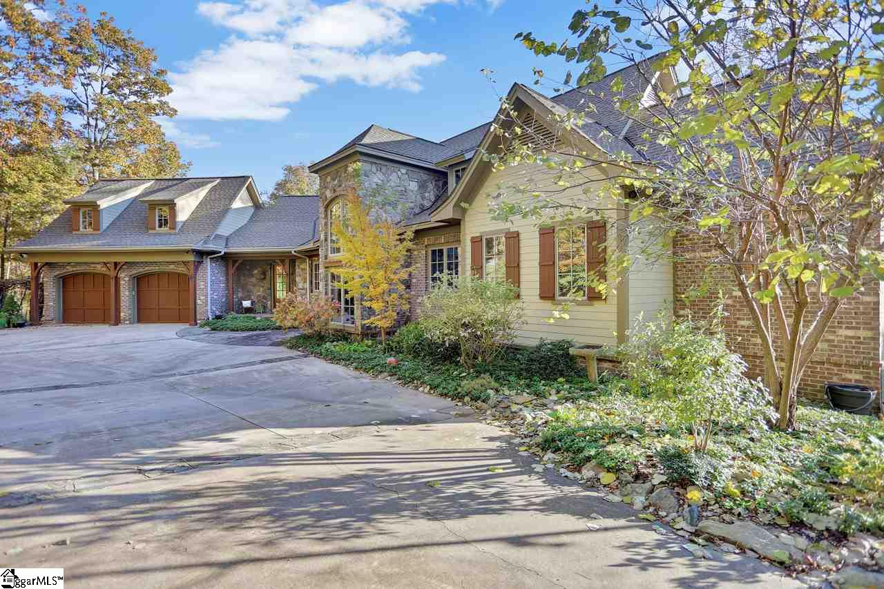 "Come to the Mountain and see why folks say, ""It's a great day on the Mountain"", and why folks rave about this gorgeous mountain home!  Nestled among the beauty that exists on Glassy Mountain, you'll find this craftsman style, three bedroom, 3 full bath luxury property.  The main level is a sight to behold as soon as you drive on the property.  Beautiful Hardboard siding and stone create the emotion you want to feel when you know you're about to see a great home.  This luxury home is a retreat waiting to happen!  Once inside the main level is exposed from kitchen to dining to great room, and the view inside the door is the gorgeous natural landscape of the mountain.  Beautiful hand-scraped hardwoods throughout the main level, accented by the focal point, rock fireplace.  Majestic as the fireplace is, the kitchen and dining room are also focal points!  The kitchen is a cook's kitchen with ease to flow from sink to stove to island.  No maze involved in getting around this cook's kitchen.  Perfectly positioned window for seeing nature while you enjoy this kitchen as well, and the island seats allow family talk while the cook does magic.  The kitchen opens to the dining space as well which has views of nature as well.  This level inspires family time because of it's layout.  Also on this level is the master onsuite.  Some people like to have more than just 4 walls for their master, and this home fits the bill on that need.  Enter the Master and find a built in chest of drawers and vanity area that can have many uses.  The Master bedroom is positioned for all that nature offers including beautiful sunrises, and a walk out private deck.  The master bath beckons anyone for a comforting whirlpool bath, large shower for big or small stature, separate vanities with sinks and a comfort area for sitting and taking care of your cosmetic needs.  The drawing card on the master bath is the beautiful nature scape you can enjoy while soaking in a bubble bath!  Head up the stairs to two amazing spaces, and you'll see a working loft area.  Uses are numerous as well, from office space, craft room, guest room(built in window-twin bed), library, kid's play room, and on and on with your imagination for its use.  On the lower level you will begin to understand the family-nature of this home even more.  The finished lower level family room sits in between the 2nd and 3rd bedrooms, giving guests their privacy.  With rock fireplace positioned perfectly, so as to not block nature's view, and finishes that speak quality of construction, you'll want to spend just as much time in this space as the main level's living room!  Both bedrooms have their own bathrooms, and the ""tasteful"" wine cellar is positioned for everyone to enjoy on this level!  Be sure to checkout the unfinished portions of this level.  Over 800 square feet of storage area, workshop area, or even a space for a studio!  Well done!  Now, you're ready for a tour so you can take in the beauty of this home and the nature that surrounds it with breathtaking views as nature allows.  Welcome to your new home at 2 Sharptop Way!"