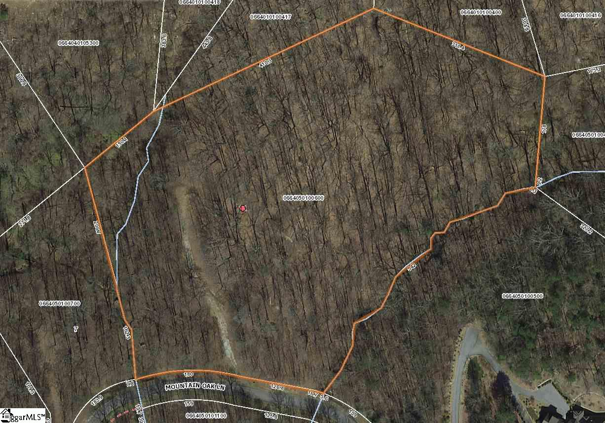 This fabulous secluded 7.5-acre homesite is the perfect setting for enjoying the peace and serenity of nature. Glorious hardwoods and two rock lined streams enhance the beauty of the great build site set deep within the property. Located across from the entrance to the Valley Nature Trail....a hiker's paradise!