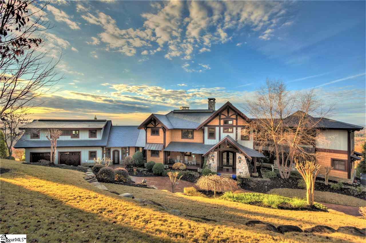 "Welcome home! This one-of-a-kind custom timber home sits atop Paris Mountain in a prestigious elevated location offering breathtaking 180-degree views of downtown Greenville, Furman University's Mirror Lake and famed bell tower, and the Blue Ridge Mountains beyond. The custom estate features exquisite craftsmanship with exposed Douglas fir beams throughout almost 6,000 sq. ft. of living space. A serene retreat, the property boasts incredible outdoor space including four decks, a patio, and fire-pit -all with spectacular vistas. Five gas and/or wood-burning fireplaces create inviting and cozy living spaces, both indoors and out. There is an immaculate gourmet kitchen with only the finest appliances and walk-in pantry. All four bedrooms are impeccably designed, each with its own luxurious bath and heated bathroom floors, any of which can be used as the master bedroom. The bedroom over the garage can double as a bonus room or in-law suite as it features a kitchenette and a queen sized Murphy bed built into the wall. The main level bonus room, previously used as an exercise room is spacious with incredible views from every angle. Other custom features include majestic entries with steel and iron doors, Amish hand-scraped solid 3/4"" hickory hardwood floors throughout, solid walnut custom 8' interior doors, some with custom glass and iron, vantage controls automatic lighting system, Marvin roll-out windows and custom tongue and groove poplar walls (no drywall anywhere), central vac, and more. Some exterior features include a 220 sq. ft. art studio, a new GAF slate roof, and a $300,000 landscaping package with tiered rock walls imported from Tennessee. This home is located off of Altamont Rd., famous to cycling enthusiasts and is minutes from the Swamp Rabbit Trail, an exercise path, leading to Travelers Rest and Greenville's best restaurants and cultural events making this fantastic home the ideal base from which to explore all that Greenville and its surroundings have to offer. Less than 15 minutes from downtown Greenville and  5 minutes to Furman University, Travelers Rest, and Hwy 25 that provides easy access to Hendersonville and Asheville, North Carolina. You MUST schedule a tour TODAY!"