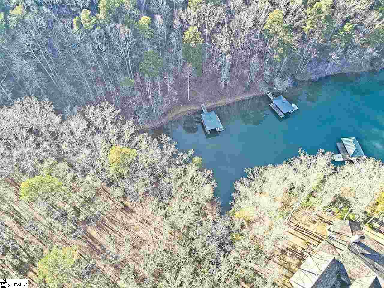 Picturesque 2.3 Acre waterfront property located in prestigious Lake Keowee gated golf course community Cliffs at Keowee Springs. Private and convenient. Just 16.6 miles to Clemson Memorial Stadium & 40 miles to downtown Greenville. End of cul de sac, private, gentle slope and great depth.
