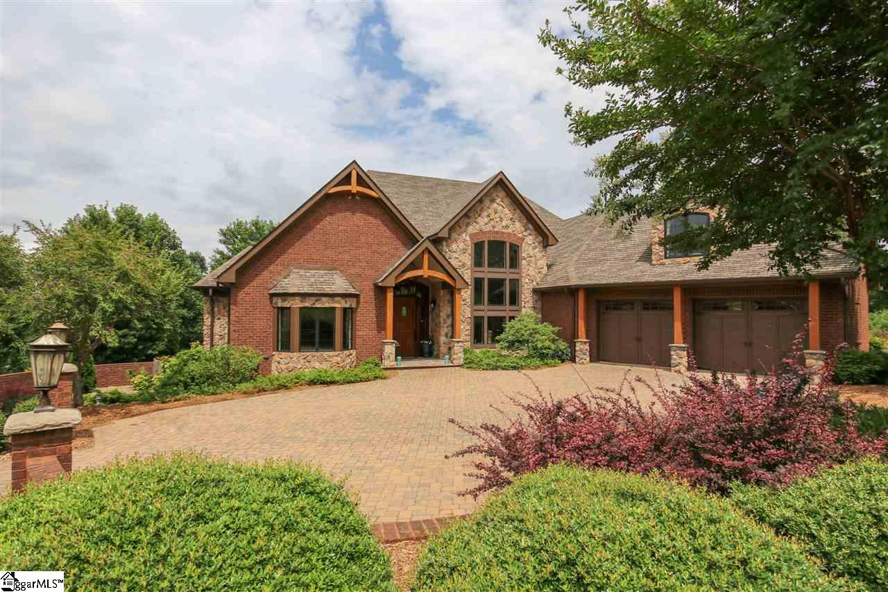 Exceptional quality is the hallmark of this custom-built home with complete in-law suite, (To include its own garage and full living quarters) … Every detail is exquisite! Upscale custom finishes including multi-piece crown molding, barrel ceiling and hardwood floors draw you into the welcoming Foyer. Just off the Foyer you will be impressed by the Living Room that greats you with French doors, bay window, and a deep trey ceiling with back lighting. The Formal Dining Room showcases ornate designed 12' ceilings, two story windows, and designer lighting. The gas log fireplace creates a casual & warm environment in the expansive Great Room along with a barrel ceiling and a wall of windows that allows plenty of natural light to fill the space. The Gourmet Kitchen flows seamlessly from the Great Room, where you will be delighted to find an extended breakfast bar, custom furniture quality cabinetry, granite counter tops, exposed beams in the tongue and groove ceiling, stainless steel upscale appliances, and a large walk-in pantry. The Kitchen opens to the Breakfast area that gives access to the Deck, which makes indoor and outdoor entertaining a breeze. The main level Master Suite is luxury personified! It has been styled with exposed wood beams, custom chandelier, and plush neutral carpet. The Master Bath will be a welcomed retreat at the end of a long day with an over-sized jetted garden tub, His and Her furniture style vanities with granite countertops, and a custom tiled walk-in shower with dual shower heads and stone pebble floor. In the ever so poplar split floor plan style the secondary bedrooms are on the opposite end of the home and share a Jack and Jill style bath with dual vanity and tile surround shower. Just up the stairs you will find a Bonus Room that is currently used as Craft Room and Office Space. The Garden level of the home features an in-law suite with laminate hardwood floors throughout. The downstairs area is truly amazing! The Kitchen is equipped w