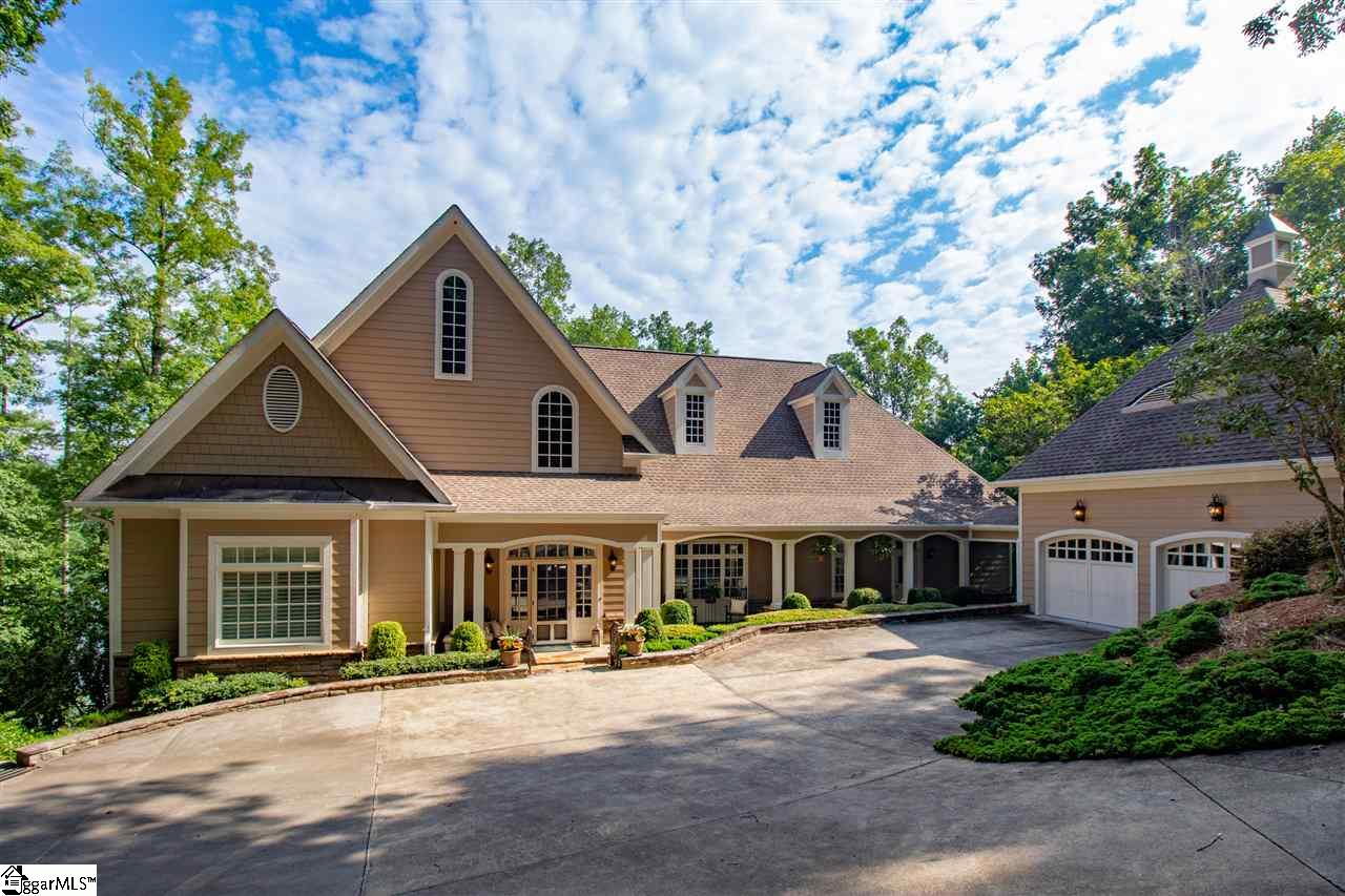 UPDATED PRICE on UPDATED LAKE FRONT HOME in The Reserve at Lake Keowee! This home makes it SO easy & fun to host a house full of friends & family. Private, gated, world-class GOLF community which also features fitness center, marina, tennis & fun pool/playground for kids! Set on QUIET COVE with 200+ feet of lake front, protected from big water noise & waves, the covered dock includes boat lift. Enjoy LAKE VIEWS from your screened porch, the Great Rm, Den & Kitchen, and FROM EVERY BEDROOM!  Open, updated, granite kitchen with top appliances and large walk-in pantry. These owners have redone/enhanced EVERY room. Stone fireplace on both levels. Master and Guest Suite on Main, three more guest suites on Terrace Level.  Absolutely THE BEST home & value under $1.5MM in any golf community on Keowee. 50 min's to Downtown Greenville, 30 min's to Death Valley/Clemson. Come see 117 Burwood Court, you'll want to relax and stay a few years.  Showings ltd to serious qualified buyers.
