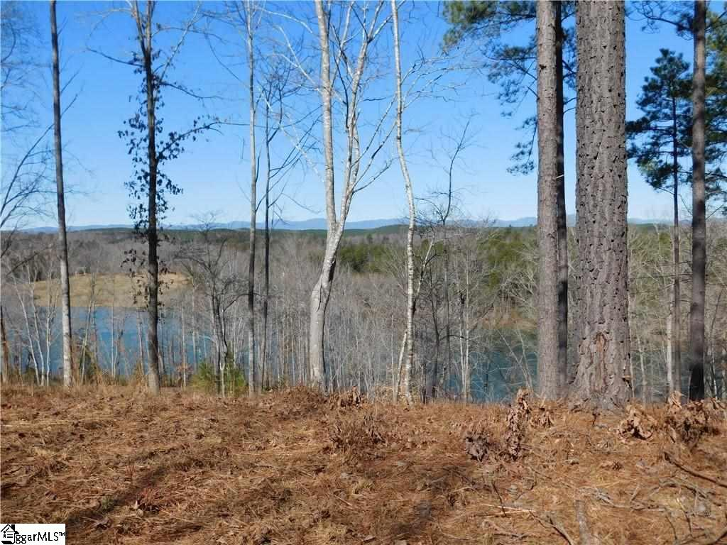 Big view of Lake Keowee and Blue Ridge Mountains! Flat build site on a private knoll setting! This large knoll setting offers privacy and the elevated homesite features a level buildsite Convenient to the Bistro (Golf Turn house) and Tom Fazio design Golf Course and walking trails. Just minutes to the Beach Club with pools, slides, day boat slips, and sandy beach area with kayaks and paddle boards. A short drive to Clemson and surrounding townships for area conveniences. Membership is available for purchase for use of amenities. Chose the level to best enhance your Cliffs living and this homesite purchase.  See Associated Docs for site plan on this homesite.