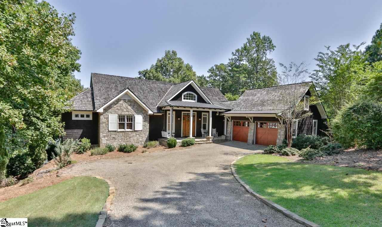 This perfect Lake Keowee waterfront home is situated on an easily maintained, VERY gently sloped homesite in one of the best areas of The Reserve! A pretty front porch wraps into a side grilling porch under breezeway. The main level open living space has heartpine floors, majestic floor to ceiling stone fireplace, lots of natural light from windows, a wood-paneled, vaulted ceiling. The lakeside rear of home faces east, with incredible views overlooking a large, deep-water cove. The spacious main level outdoor deck is about 800 sf; almost half is under roof. Custom cabinetry & built-ins are throughout. The kitchen features 2 dishwashers & Dacor gas cooktop. Master suite on main level, as well as one guest.All 4 bedrooms have adjoining baths; in addition, a guest suite is in bonus over garage. Terrace living area has slate floors, stone fireplace. Easy access to lakeside terrace and covered dock (with lift) via stone steps with handrails. The level side yard is a great play area.Laundry is situated on the main level;hook-ups for additional laundry downstairs.Gentle drive(pea gravel w/base) to an oversized double garage.   RLK club premier membership required ($60,000 deposit, not included in price; to be paid at closing).  PURCHASE HOMESITE BEFORE JUNE 30, 2020 to make certain this is a completely refundable deposit upon any future resale. Call listing agent for more information.