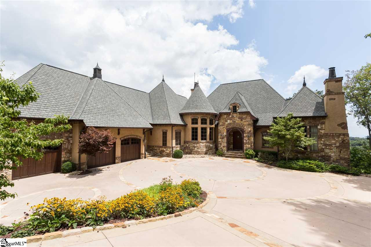 BEAUTIFUL, CUSTOM BUILT, EUROPEAN STYLE HOME OVERLOOKING THE WORLD AND SITUATED HIGH ATOP THE PREMIER NEIGHBORHOOD OF CLIFFS @ GLASSY. ONCE INSIDE THE GATED COMMUNITY, YOU BEGIN TO LOSE THE HUSTLE AND BUSTLE OF THE DAILY GRIND AND FALL INTO SERENITY AS THE ROAD GENTLY SWAYS AND LEADS YOU THROUGH A MYRIAD OF LUSH, GREEN MOUNTAINS AND GENTLE, COOL BREEZES. AS YOU APPROACH THE ESTATE, YOU ARE QUICKLY GREETED BY A IMPECCABLE ARCHITECTURAL LINES, SEDUCTIVE SHAPED CUSTOM DRIVEWAY, LUSH LANDSCAPING AND A STUNNING FRONT ENTRYWAY WITH EXPOSED BEAMS, STONE AND BRICK ANSD BEAUTIFULLY CRAFTED DOORS. AS YOU ENTER INTO THE FOYER, YOU ARE IMMEDIATELY DRAWN TO SO MANY EXQUISITE ARCHITECTURAL FEATURES. FROM THE CONICAL CEILING IN THE GREAT ROOM TO THE FLOOR TO CEILING STONE FIREPLACES IN THE DINING ROOM, GREAT ROOM AND LOWER LEVEL DEN. THE HOUSE EXUDES SUPERIOR CRAFTSMANSHIP THROUGHOUT. THE  INTERIOR FEATURES INCLUDE MASTER ON THE MAIN WITH FULL DRESSING ROOM, HARDWOOD FLOORS, CERAMIC TILED FLOORING IN THE KITCHEN AND BATHROOMS, TOP OF THE LINE APPLIANCES, GRANITE COUNTERS, SPACIOUS BEDROOMS, MEDIA ROOM, OFFICE, STUNNING SPIRAL WROUGHT IRON STAIRCASE, LARGE LAUNDRY ROOM AND EXTRA STORAGE AREA & THE LIST GOES ON AND ON. THE SELLERS ADDED AHUGE BATHROOM DOWNSTAIRS. THE EXTERIOR FEATURES SOME OF THE MOST STUNNING VIEWS, 2 FLAGSTONE PORCHES, OUTDOOR FIREPLACE, GENERATOR, BUILT IN DEHUMIDIFIER, HIGH END WINDOWS AND DOORS, LARGE 3 CAR GARAGE AND DID I MENTION THE VIEWS!!??? THIS HOME HAS WARM SULTRY TONES AND SOME OF THE BEST FINISHING WORK THAT I HAVE SEEN. DON'T JUST VISIT...LIVE IT!!