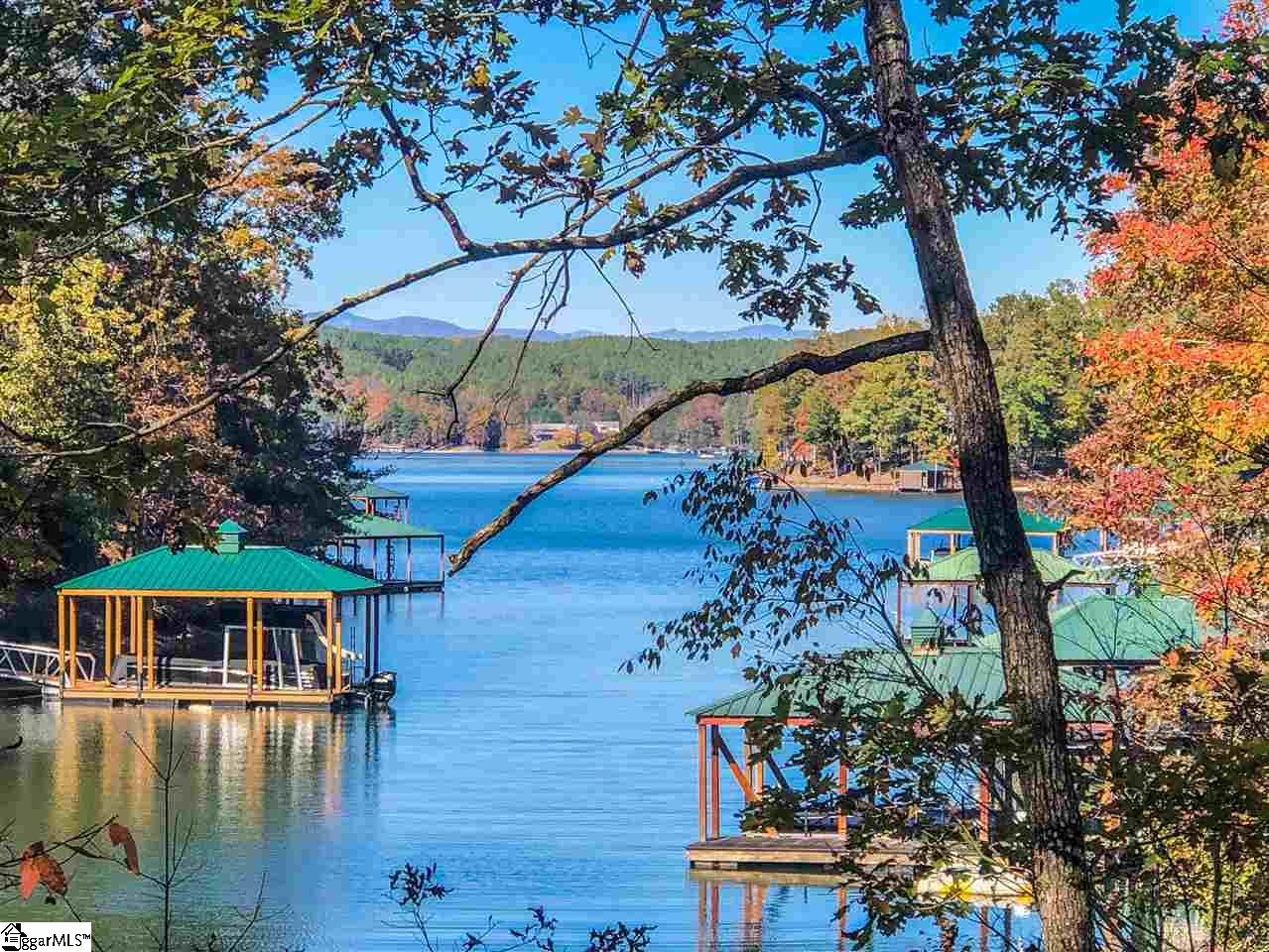 Unique opportunity! Wonderful waterfront lot with gentle slope and ideal building envelope. Larger than most lots at 2.34 acres. Long water views with over 380 ft. of waterfront and perfect for swimming access or launching a kayak. Price reflects water view/access lot. Membership is available as separate purchase with multiple levels to choose from. Community amenities include Fazio golf course, Bistro restaurant, Beach Club with pool, Wellness facility, lots of walking trails and a club house coming soon! The Cliffs at Keowee Springs is one of three communities that surround Lake Keowee and one of seven total Cliffs Communities offering an impressive variety of amenities available upon joining the Club. Just minutes to the gatehouse for accessing area townships and everyday conveniences and shopping.  Please note, this lot is non-dockable.
