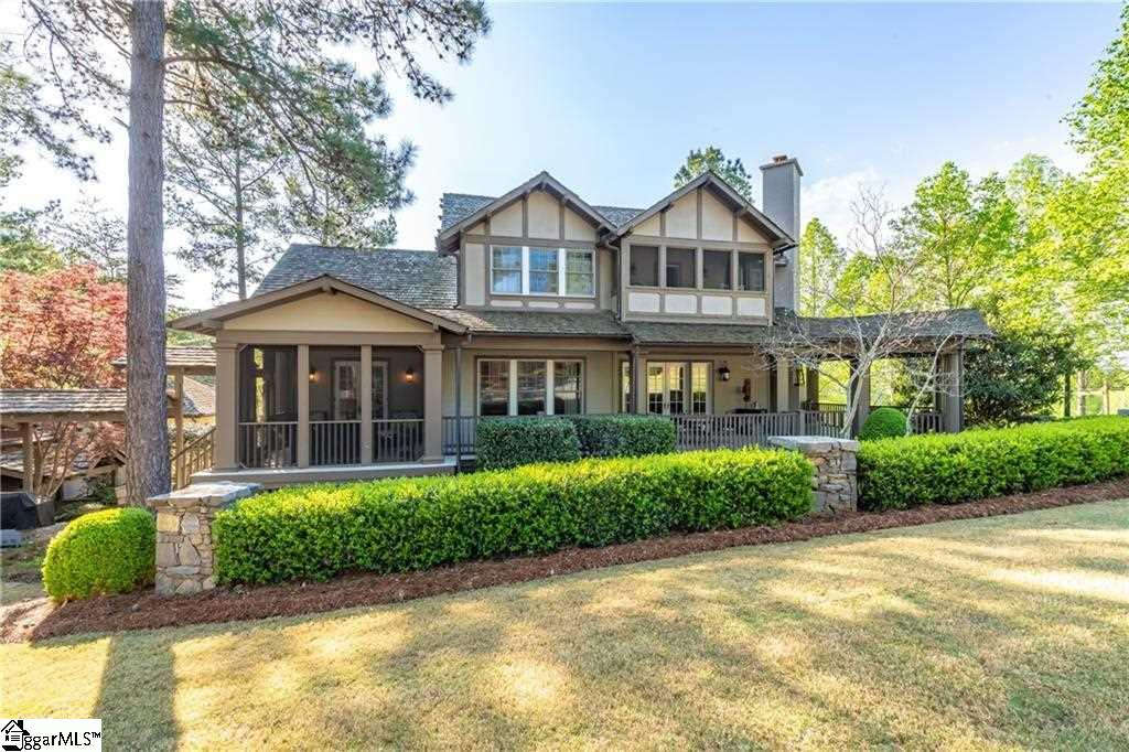 This Craftsman design home is located on the Great Lawn at the Reserve at Lake Keowee. Furnishings included! The wide porches and deep open over-hangs with exposed rafters are part of the charm of this home. The Hill House design makes full use of these, with a focus on the great outdoors. The outdoor corner fireplace provides a wonderful gathering place. Upstairs, the large loft area can double as a library. The design elements of this home are 4 bedrooms, 4 full and 1 half bath. Timeless traditions and memory filled summers begin here. Close to our quaint Village and all the amenities, this home enjoys a front row location in the community. This house was the premier model home and had a professional designer for the interior. The Reserve at Lake Keowee offers a Jack Nicklaus Signature Golf Course, a new par 3 practice facility with driving range, Clubhouse with fine dining, pub area and wine bar, Fitness Center, Hiking Trails, Har-Tru Clay Tennis Courts, Lakeside Resort-Style Pool and Cabana, Pickleball Courts, Marina offering both slips and boat rentals, and Market great for lunch and select provisions. This gated community offers many activities including fitness classes, various social clubs, and a high speed fiber-optic internet system in place. The Reserve at Lake Keowee is a full amenity lakefront golf community. Membership is required and can be converted to a sports or social.