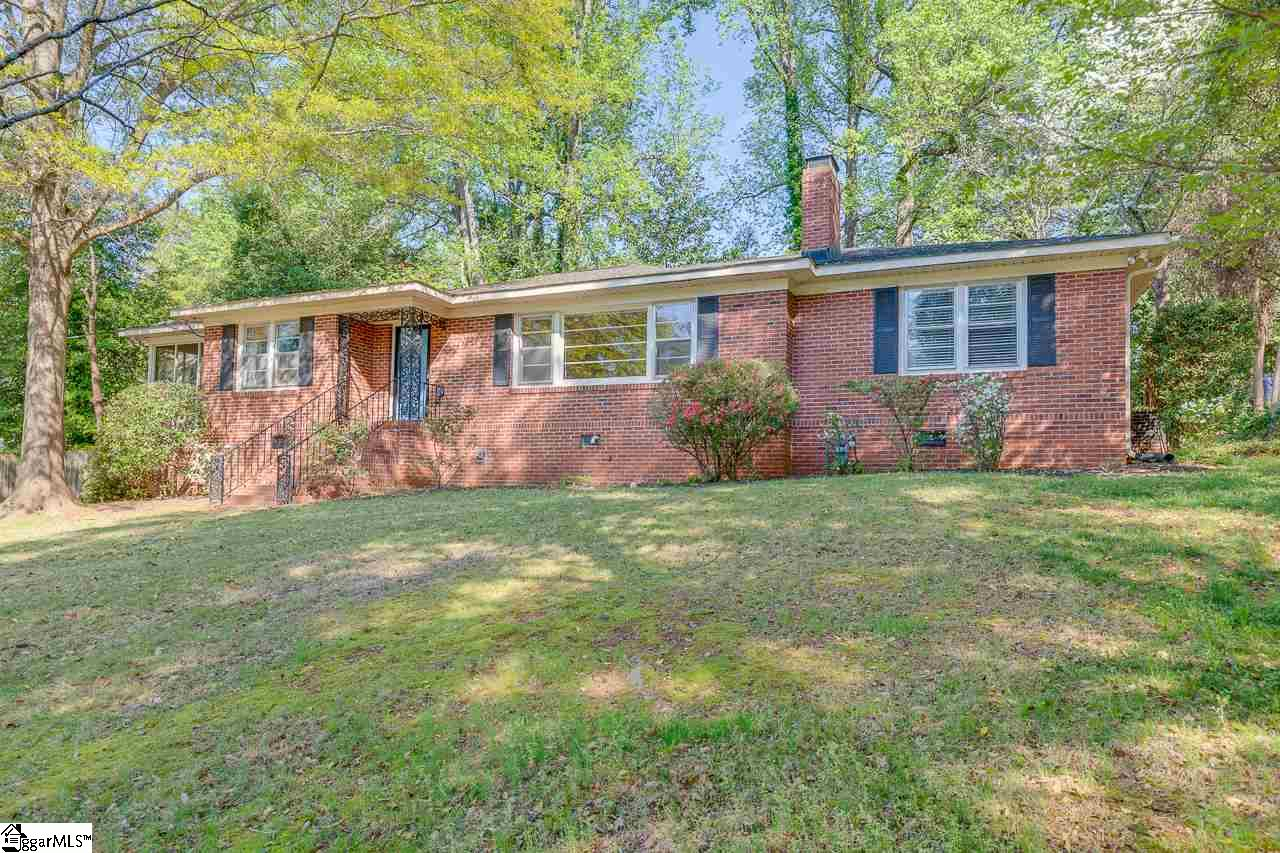 DESIRABLE, ELEGANT BRICK RANCH IN FABULOUS LOCATION!  This 3BR/2BA traditional ranch features nearly