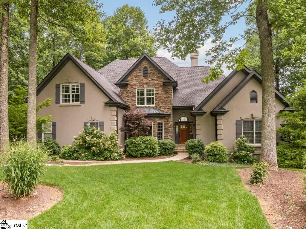 """What an amazing property in an amazing community!!!!  The beautifully landscaped yard, the Crab Orchard stone pathways around home, gorgeous European look, and feel, will get you out of your car and into this home without delay.  The beautiful masonry stucco and rock accent fits in with the natural surroundings quite well.  Enjoy the relaxing view of the 12th green and 3 ponds as soon as you enter the front door.  Just entering the front door is a stress reducer!   With working from home in place this home is already prepped!  High speed internet, and 2 office areas, one on each level.  Of course, fantastic views from each!!!! The main level has a large, well placed, dining room, and a large great room with floor to ceiling windows to not miss an inch of the scenic golf course.  On this level is the Master ensuite and newly updated kitchen that opens to the great room. Breakfast is sure to be a hit from the gorgeous screened in porch with rock fireplace.  Walk out to the Multi-level Brazilian hardwood IPE deck or stay in to enjoy the magnificent views.  Of course Vitamin D awaits you on the deck that overlooks a water feature, golf course, 3 ponds, expansive wild flower garden, and more gorgeous landscaping.  Hog Back Mountain can be seen in the distance as well. The Master Ensuite is over-sized with a sitting room with views of the golf course.  On the second level are 3 more bedrooms, foyer space, and a large office/study/sunroom with amazing views!!!!  This home comes with many system upgrades including whole house generator, whole home air filtration system, crawl space encapsulation and a SaniDry dehumidifier.  Home is a relaxing stone throw to the 12th green, and it can all be yours!  Come see this beautiful home within the mountain community of The Cliffs at Glassy. The Cliffs at Glassy golf course was voted """"the 4th most aesthetically beautiful course in the country"""" by Golf Digest.  Club memberships are available with the purchase of this property. Spectrum"""