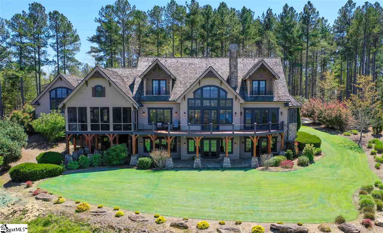 THE MOST SPECTACULAR, PANORAMIC MOUNTAIN & LAKE VIEWS of any home, any resort on Lake Keowee (or Jocasee). Custom built on 2.86 acre level lot, one of the first lots chosen in the original Founders Section (F) owing to its breathtaking views of the Blue Ridge Mountains. Meticulously maintained home welcomes you with breathtaking views from most every room & relaxes you with its comfortable elegance. Rain or shine, summer & winter, sunrise to each specular sunset, the tableau outside every window will make this your favorite retreat EVER. Plus: enjoy RLK's strong sense of COMMUNITY via golf, tennis, fitness center, pool, playground & marina, with reserved boat slips & storage. Anyone can have a lake view, at 410 Top Ridge you come home to spectacular lake & MOUNTAIN views, every day. 24 hr notice, showings ltd to serious, qualified buyers, documentation required in advance.