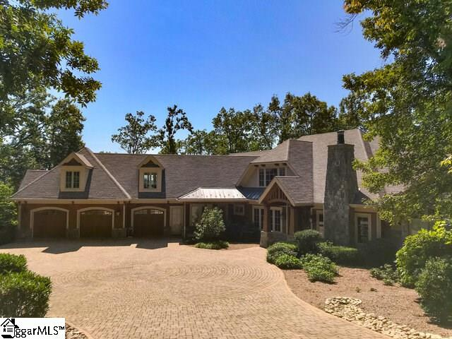 This gorgeous, custom-built mountain retreat in the Cliffs Valley can accommodate all your family & friends! 5BR's, 5 Full BA's, 4 Half BA's, 2nd full living space with kitchen, Elevator access to all 3 floors, library with fireplace , exercise room, media room, billiard/bonus room, Home-Office, keeping room off kitchen with fireplace and access to large screened porch. Outdoor living space with magnificent views, covered patio, huge firepit and cascading man-made stream. Huge workshop with half bath, 3-car garage with half bath and abundant storage space. Multiple en suite bedrooms. The list goes on and on. Built with thoughtful design, fine architectural detail and an utterly impressive level of quality in the materials used and the craftsmanship applied, no convenience or amenity was overlooked. To top it all off, the property comes with an adjacent separate and build-able lot to total an incredible 7 Acres of nearly pristine privacy in the Stone Creek section of the Valley...a very short drive away from the various exciting Cliffs amenities and just a little further the convenient back entrance to the community. All-in-all, a spectacular property that is unmatched in the local marketplace.