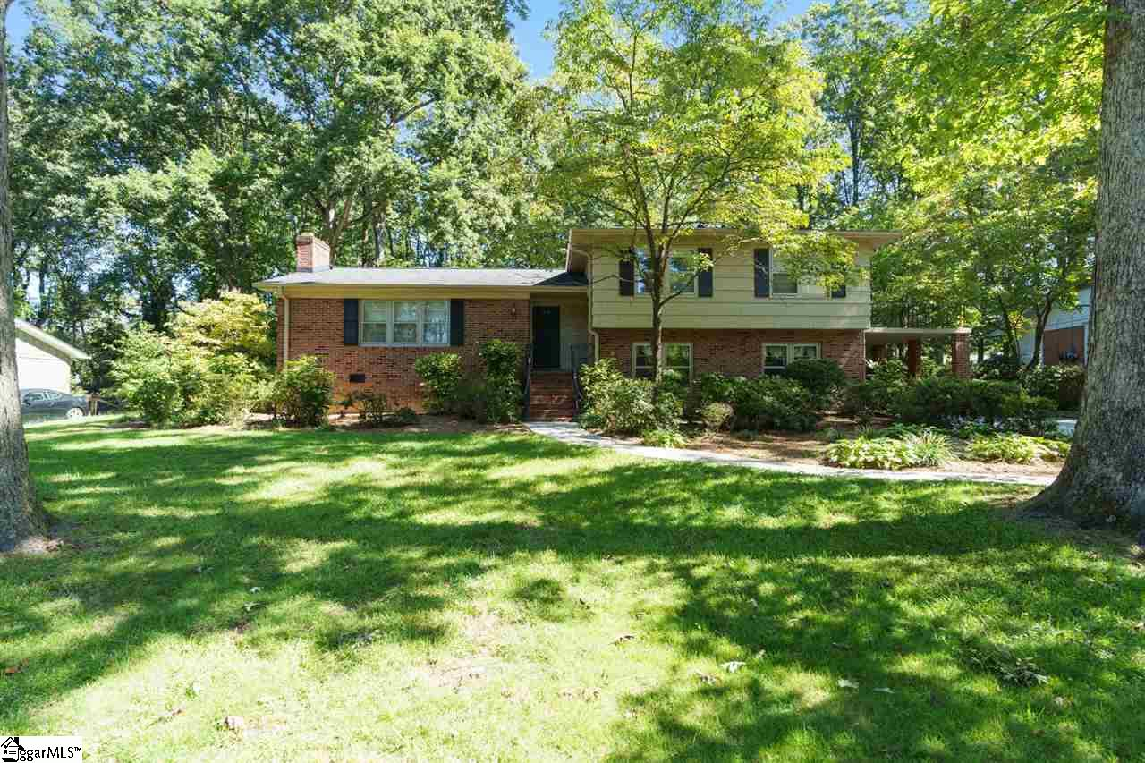 Location, Location...This charming 4 bedroom 2.5 bath home is convenient to everything. Three bedrooms and 2 baths up and another bedroom in the basement along with a Large den area and a half bath. Perfect for in-law suite with its own entrance. Formal dining room. Wood floors in living spaces and under carpet in bedrooms. Generous sized kitchen and breakfast area. Very private back yard with a park-like feel. Come and view this home....you won't be disappointed.