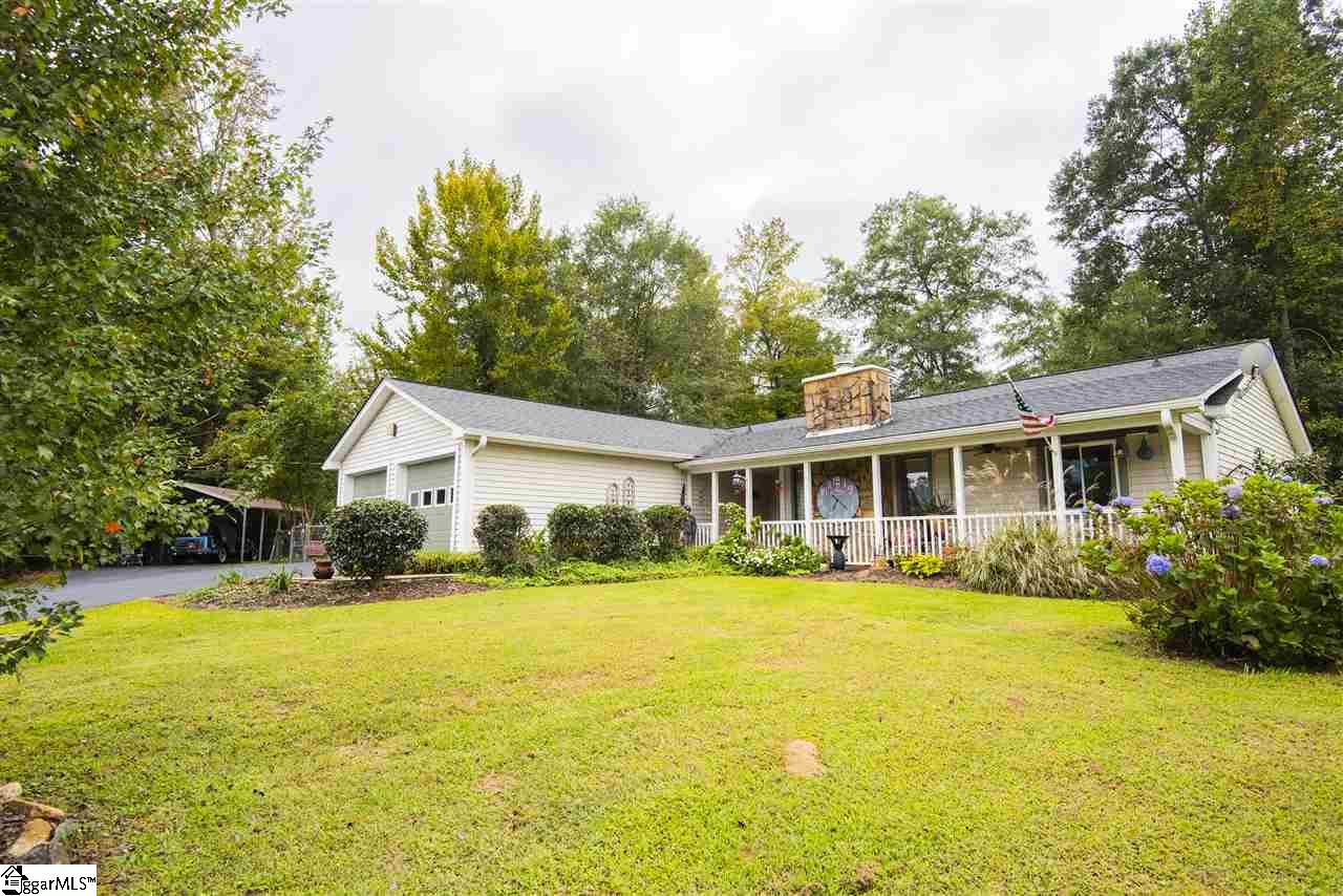 Charming ranch style home on over an acre, enjoy your morning coffee on the beautiful front porch, or in the newly added sun room. This 3 bed 2 bath charmer has a new kitchen with granite counter-tops, custom cabinets and newer stainless appliances. Beautiful laminate floors throughout.  This home has a built in back up generator and new HVAC added in March 2019.  The property also features a newer huge steel building with double garage doors and electric, carport for extra parking, a cute chicken coop, courtyard, koi pond and a she shed along with a huge terrace in the back of the yard with built in fire pit, and a storage building for your yard equipment. Don't miss out on this adorable home schedule your showing today.