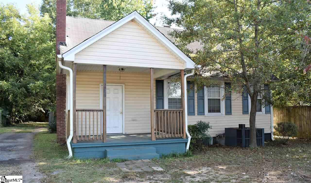 Located just minutes from Downtown Greenville, Main Street Shopping, Dining, Falls Park, and the Greenville Drive Baseball Stadium this hard to find 4-bedroom, 2 bath home boasts an even harder to find oversized lot with unfinished space inside to expand! This incredible opportunity features a large living room and spacious kitchen along with a separate eat in and laundry room. With 3 bedrooms and a full bath on main, the second level is reserved for the entire master suite and private full bath. At the top of the stairs you will also find a large, walk in attic with unfinished spaces just waiting for your personal touches. The fenced in back yard offers a natural back drop for privacy and the extra long drive allows for plenty of parking.  Investors take note – this home has a long term rental history and would make an excellent addition to any portfolio OR take advantage of the perfect handyman special and turn it into your very own home sweet home and become a part of the growing number of neighborhood renovations happening in the surrounding downtown areas! Sold strictly as-is with cash or conventional preferred. This one will NOT last long so schedule your private showing today before someone else puts it under contract tomorrow!