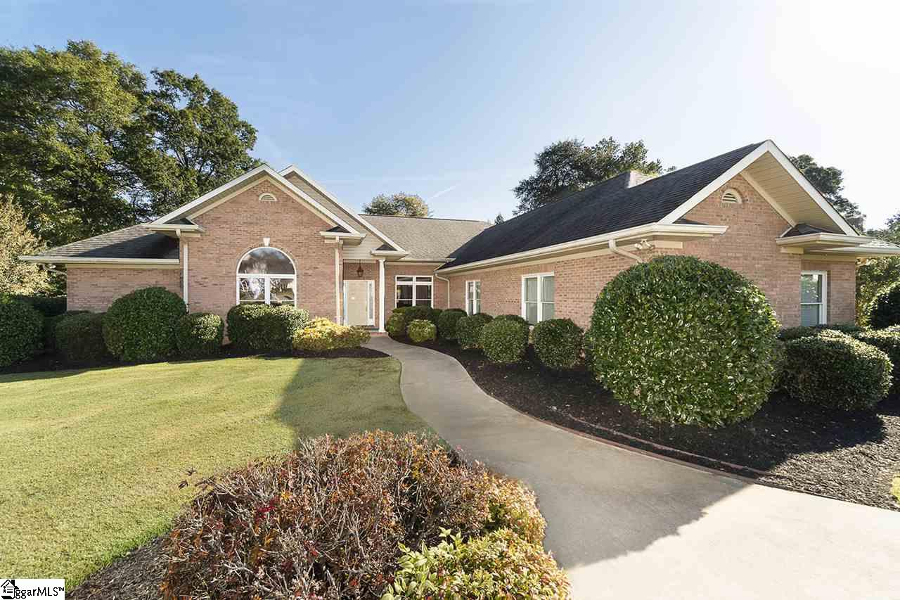 Located with one of the most beautiful views on Smithfield County Club golf course, this 4 bedroom, 4 bathroom home has it all! As you enter the front door, your eyes will automatically be drawn to the large windows, looking out back over the tee box of hole #2, and the club house. Before we travel outside, lets talk about the inside where you will find a huge living room with custom cabinets, a wet bar, and a large gas fireplace. The kitchen is ready to entertain with granite counter tops, abundant cabinet space, pantry, and an island. Adjacent to the kitchen area is a cozy den with your second gas fireplace, custom built ins and Breakfast nook with bay window seating. This home also features a formal dining room with tray ceilings. Wake every morning to at beautiful view of the golf course from your large master bedroom with covered porch assess. The bedroom features his and hers walk-in closets, a separate room with toilet and bidet, a huge bathroom with a jetted tub, separate shower, and his and hers sinks. There is another bedroom/office located on the same side as the master bedroom with a walk-in closet. On the opposite side of the home, you will find 2 more large bedrooms with their very own full bathroom in each. The home is equipped with plenty of storage space, central vacuum system, and intercom system. Outside, a large backyard with .74 acres awaits. There is a large screened in porch, and open an open air porch, and a covered porch. Enjoy the view of the pond on the course and a creek that runs along the back of the property. Underneath the home is a place to store your golf cart and you are sitting right next to a golf cart public access, where you can pull out of your storage and be on the course in seconds. Don't miss this one.....WELCOME HOME!