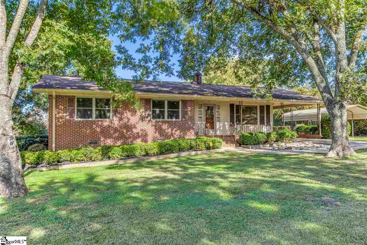 3/2 BRICK RANCH. 1,424 SQFT. NEW ROOF INSTALLED 2000. REPAIRS TO CHIMNEY MADE. NEW HVAC SYSTEMS INSTALLED 2014-2015. GAS LOG FIREPLACE. HARDWOOD FLOORS UNDER CARPET. Don't miss out on this charming 3 bedroom 2 bathroom, 1,424 sqft Greenville home! This sturdy, brick ranch was built in 1974 and has been fantastically maintained. Its shady front yard and comfy front porch provide ideal curb appeal, while a spacious deck dazzles in the backyard. The home offers exterior conveniences like a covered 2 car carport and a large outbuilding. Inside, you'll enjoy the comfortable living spaces. A gas log fireplace is the perfect spot to warm yourself on chilly nights, and the home's well maintained carpet overlays hardwood floors, providing you with tons of options! The kitchen has generous cabinet space with plenty of room for storage, and is great for gathering with friends and loved ones. The spacious master bedroom has a comfortable full bathroom en suite and is a great retreat at the end of the day. The area that shines the brightest in this home has to be its fabulous sunroom. Enjoy your morning coffee here, or host guests; the options are yours! Accompanying the attractive amenities, this home has the updates where it counts the most. A new roof was installed in 2000, repairs have been made to the home's chimney, and both HVAC units were replaced in 2014 and 2015. Zoned for Berea Elementary School, Berea Middle School, and Berea High School, this home is in a great location in the Upstate! Here, you're only 10 minutes from downtown Greenville, one of the most renowned and celebrated cities not only in South Carolina, but nationwide! This is the ideal place for you to enjoy the city's shopping, food, culture, art, and music offerings. With many of the area's newest additions like Gather Greenville, The Commons, and Hampton Station all boasting dozens of restaurants, bars, shops, and fun local activities, the fun is waiting for you in this home! Call to schedule your showing today!