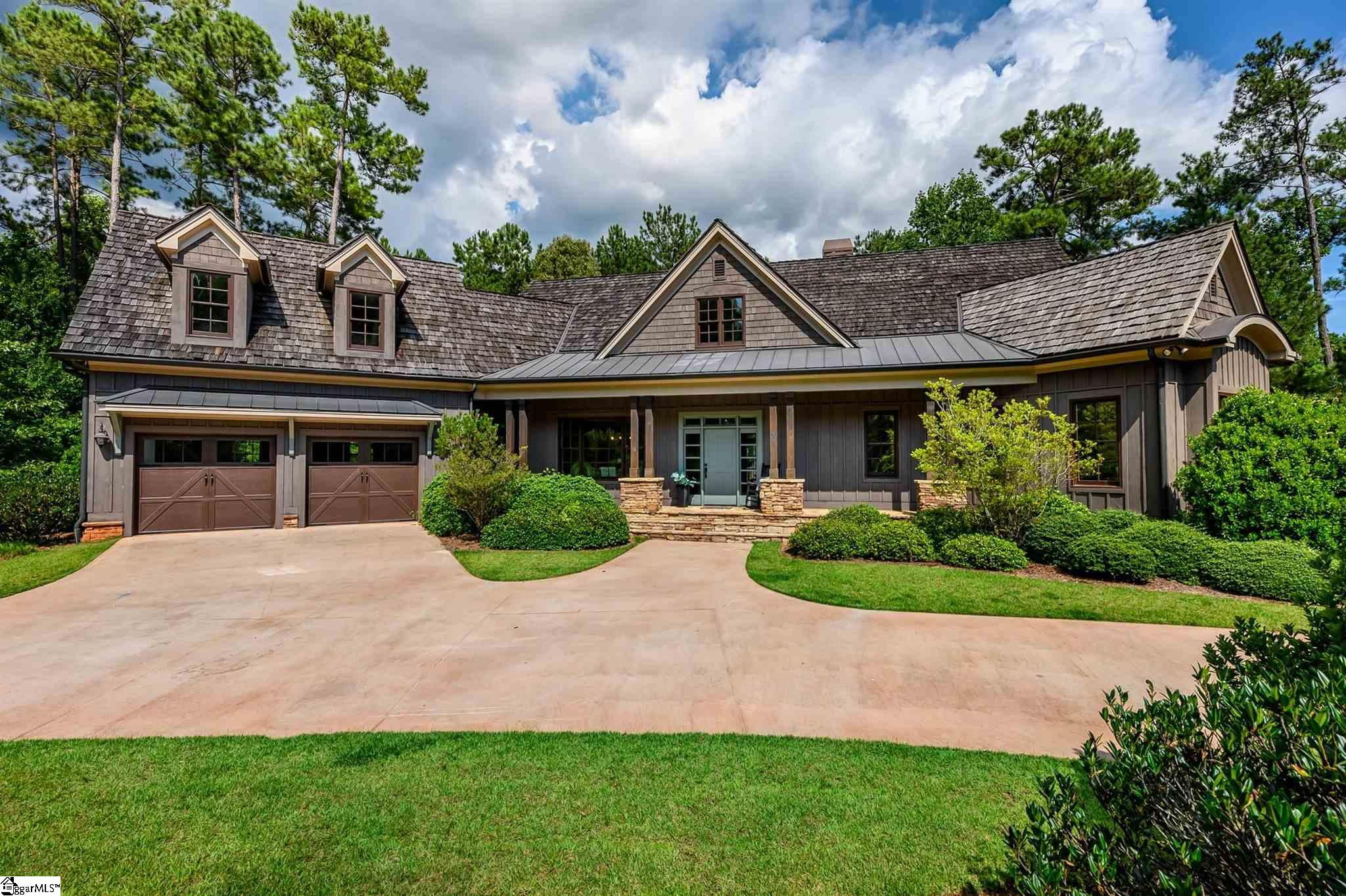This newly renovated 3 story home sits on the 6th hole of the Jack Nicklaus Signature Golf Course at the Reserve at Lake Keowee. The main level includes a master bedroom, separate dining room, eat in kitchen, office and great room showcases a floor to ceiling stone fireplace and beautiful views of the course. The upper level features a loft, 3 bedrooms, two bathrooms and a bonus room that could be converted into another bedroom or second office. The lower level encompasses a large rec room with built in cabinets flanking the second fireplace, a second kitchen, 2nd master bedroom, 2 bathrooms and workshop. This home's location has an easy golf cart ride to amenities as well as easy access to 133 for quicker trips to neighboring towns. The Reserve at Lake Keowee is a private waterfront golf community that blends natural beauty with world-class amenities. The Reserve offers over $100 million in completed amenities to include: A $2 million renovated Nicklaus golf course completed in September 2020, Orchard House, Village Center with market, Pool Pavilion, Marina, new Fitness Center, new Par 3 course with Mulberry Pavilion & Bar and much more. $60,000 Premier Membership Deposit Required.