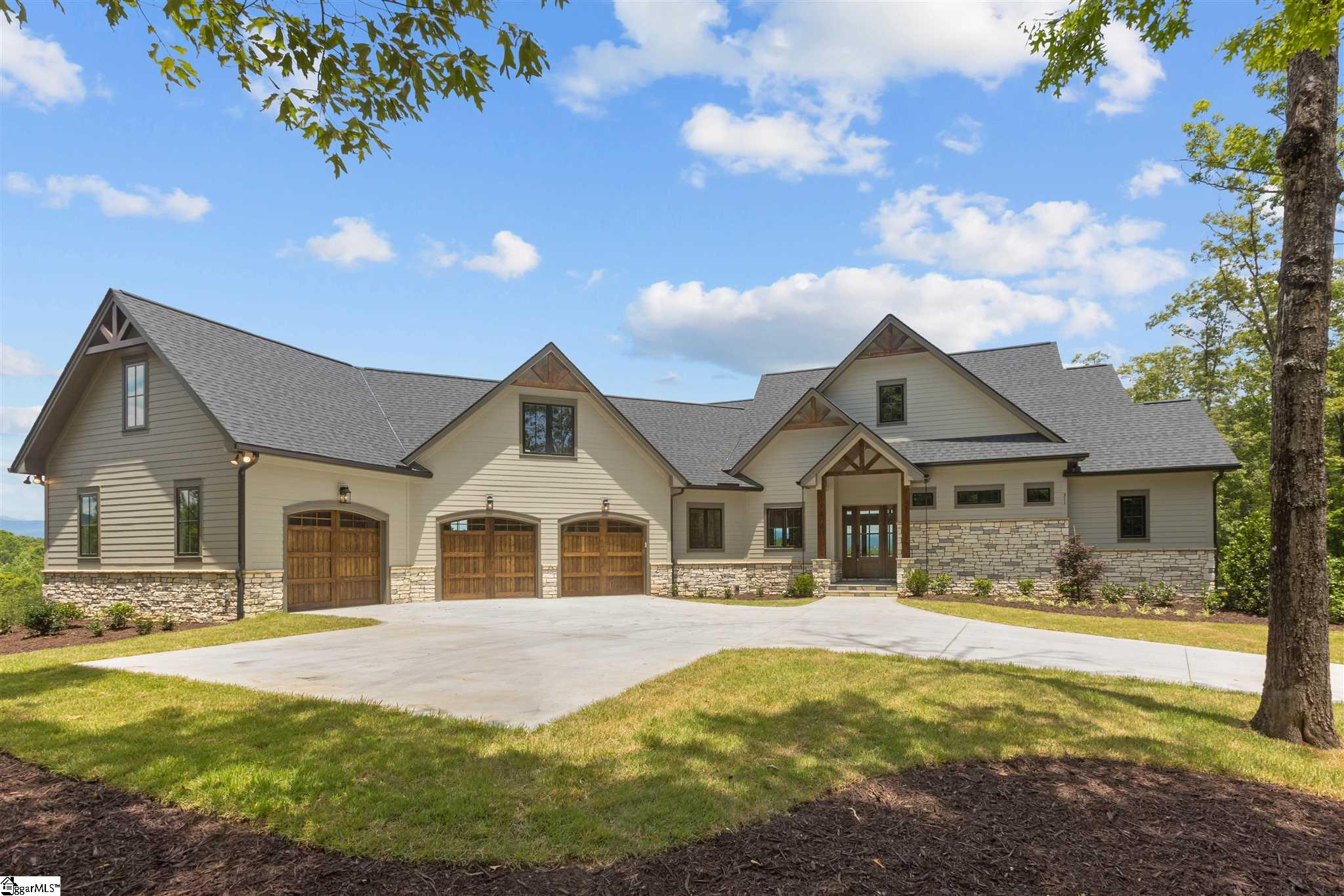 Unique opportunity to purchase beautiful, brand new custom home (just completed) with an abundance of outdoor living spaces and spectacular views of the adjoining rolling meadows with the Blue Ridge Mountains as a backdrop. Private 2.92 acre lot located at the end of a cul-de-sac with only 4 large estate-sized lots on the street. Boat slips (separate annual lease) are available within a short golf cart ride down Shimmering Water Way. Upon entering the residence, your eyes are drawn to the stunning mountain views. The great room has a 16' wide, arched window wall, a floor-to-ceiling stone fireplace flanked by custom built-in cabinets and shelves, and finished wood beams compliment the vaulted ceiling. The kitchen is a cook's dream with large center island, Taj Mahal quartzite slab countertops, top-of-the line appliances (Wolf, Sub-Zero, Miele) and fixtures. This kitchen is both a workable food preparation area as well as an entertainment and conversational hub. The passage hall from kitchen to the garage (Soho brick floors) provides access to a large laundry room (custom cabinets, soapstone slab counters and farmers sink), pantry with finished shelving and the powder room. The kitchen and dining room also provide wonderful mountain vistas. The dining room is the perfect size for those holiday get-togethers. The spacious, open floor plan allows easy communication flow between living room, kitchen and dining areas - perfect for family, friends and guests. 8' tall sliding glass doors provide a seamless transition from the dining room into a 26' x 14' all-season room with floor-to-ceiling stone fireplace to enjoy those cool fall/winter evenings. This is only one of the four covered, outdoor living areas (two on main level, two on lower level) that take full advantage of this one-of-a-kind setting. The generous master bedroom offers majestic mountain views, a coffered ceiling and an ensuite bath with large travertine marble shower, separate his-and-her vanities and separa