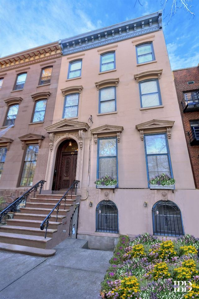 A truly extraordinary 25' wide brownstone townhouse on a 100' deep property. This gem is built in 1894 across from the Van Vorst Park, where the premier townhouses where built along this quiet tree-lined street. This neighborhood is one of Downtown's most culturally and architecturally interesting. This home was renovated twice in 2003 and again by the present owner integrating both boundless elegance yet so easy to live in – the public gathering rooms of this home offer the space and comfort for both grand entertaining and quiet get togethers. The impressive parlor, with floor to ceiling windows consists of a formal and an informal living room, a formal dining room and a spacious eat-in kitchen that overlooks one of the most serine backyards in downtown. This four (4) story townhouse has four (4) bedrooms, four (4) full baths, four (4) fireplaces along with front and rear gardens. The gracious bedroom floors include a third floor master suite that faces the green canopy of Van Vorst Park along with an abundance of closets. Additional luxuries of this remarkable townhome includes two laundry rooms, audio/video wiring throughout, multi-zone heat and air conditioning system and semi-finished basement. 293 York Street is one of this neighborhood's true treasures. Four (4) blocks from the Grove Street Path Station and the Ferry. In the townhome's garden level (no access to yard) sits a large, separate entranced two (2) bedroom apartment that has been fully renovated producing a handsome monthly rent.