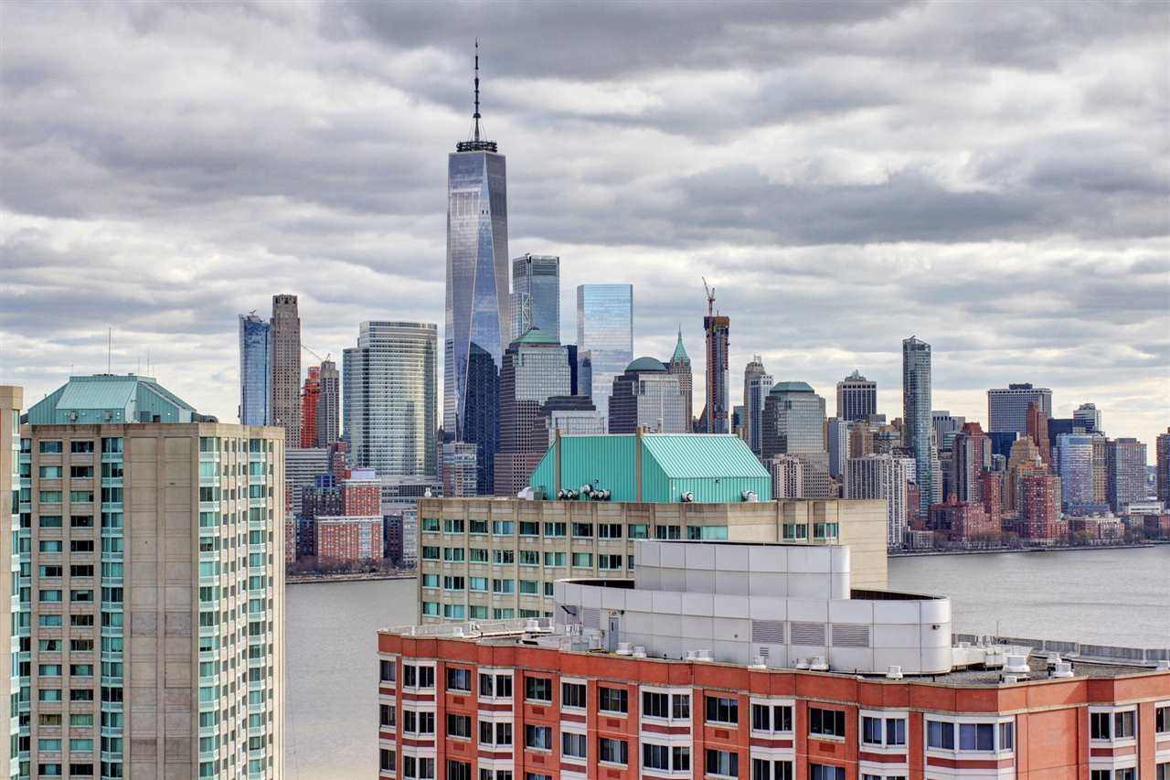 Top of the World Penthouse Living is yours in this sophisticated 2133 sf duplex with commanding views of the Hudson River and Lower Manhattan and the Freedom Tower.  Situated in one of the Riverfront's premier doorman buildings and perched on the 34th floor high above the hustle and bustle, this sundrenched south and east facing home has all the grace, style and space you require for gracious entertaining of family, friends and clients.  This home offers three separate balcony spaces from which to enjoy the views and impress your guests with your urban chic lifestyle.  The home boasts many well thought out and meticulously planned updates over the years including lovely hewn wood floors, gallery lighting, crown mouldings and millwork, gourmet style kitchen with gas cooking and expansive work space sure to please the adventuresome home chef, marble baths with deep soaking and whirlpool tubs and custom closets.  Whole home sound system speakers, entertainment center built-ins, upgraded heating controls and in-home laundry center-- even hot and cold running water on the balcony--  ensure that you enjoy the upscale comfort and panache that this home offers.  The Emerald offers a recently remodeled lobby and entry with concierge, new state of the art fitness and wellness facility, planned tennis court  and community room, large outdoor space and all the services you would expect in high end luxury high rise buildings.  Located in the Newport section of Jersey City, the transportation options are endless; just steps to PATH, ferry and Hudson Bergen Light Rail.  Newport is a community enclave featuring all the shopping you need, numerous restaurants and goods and services right outside your door.  Just seconds to Mall with theaters, high end shopping and additional restaurants.   Parking is available in adjacent parking facility.    If you want it all, don't miss seeing this excellent opportunity to enjoy the best of waterfront city living .