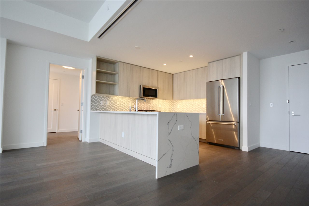 HALF BROKER FEE PAID BY LANDLORD!!!  Welcome home to your stunning luxury new construction 1,570sf rental situated directly along the Hudson River at the highly sought after Avora with 1 garage parking space included. Oversized floor to ceiling windows in every room bring in panoramic North East views of the Hudson River, NYC Skyline & Weehawken Waterfront. This 2 bedroom, 2 bathroom unit features: wide plank hardwood flooring, state-of-the-art kitchen with European cabinetry, Porcelain countertops, Professional-grade appliances & Stackable Washer/Dryer. The master bedroom features an oversized walk-in closet and luxurious en suite bath featuring an oversized soaking tub, enclosed glass marble shower, double vanities and an enclosed glass toilet closet.  The guest bedroom is also oversized with large closets and a full bathroom attached.  Hotel like amenities include 24 hr. Concierge, a Fitness Center, a private screening theater, a business center, a grand salon lounge with a bar and catering kitchen, an Outdoor Plaza with a pool, sun deck grilling areas and a fire pit overlooking the Hudson River and NYC Skyline. The NY Waterway Ferry is at your doorstep as well as the Light Rail.