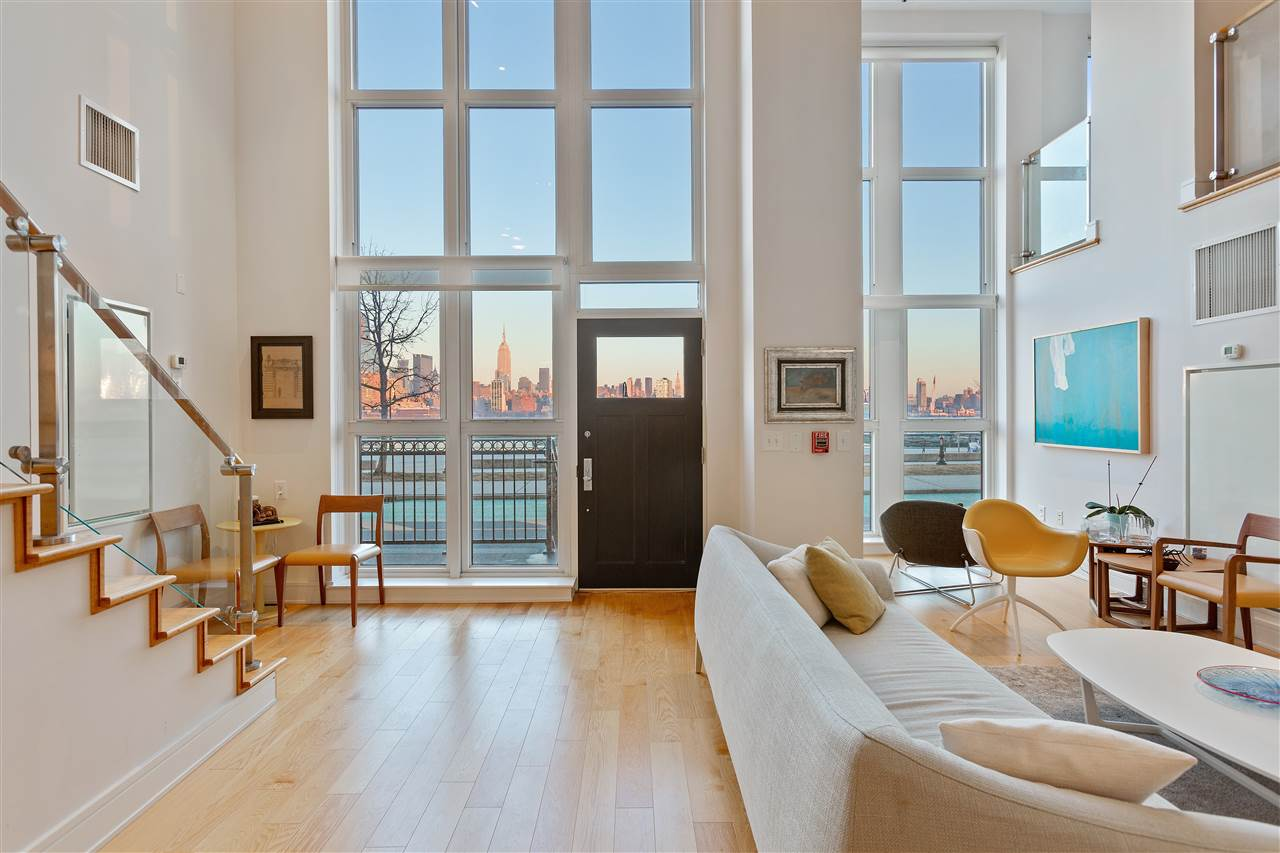 Very rare opportunity to own what many consider the pinnacle of the Hoboken waterfront.  Breathtaking views are yours from almost every room and every space of this high quality construction.  The front door of this waterfront home literally opens to the most stunning waterfront NYC skyline view in the Greater NYC area. Steps away from a ferry minutes from Manhattan.  With easy access to Lincoln Tunnel, Holland Tunnel, the ferry system, Light Rail, Hoboken Hop, and NJ Transit busses, Hoboken has become one of THE places to live in the greater NYC area making it a go to for many who require the highest quality of lifestyles while staying close to the city.  Inside you find taste and beauty wall to wall.  Professional grade Viking appliances, hardwood floors, formal living and casual family space, 3 bedrooms and 4 full baths as well as a plenty of storage space and multiple entrances.  Stunning views are yours from most every major space in this three-story Hoboken waterfront home.  Privacy can also be yours with multiple exits and your private garage parking spot just steps from the main interior entrance.  Concierge, fitness room, rooftop pool and hot tub and social areas are all available to you.