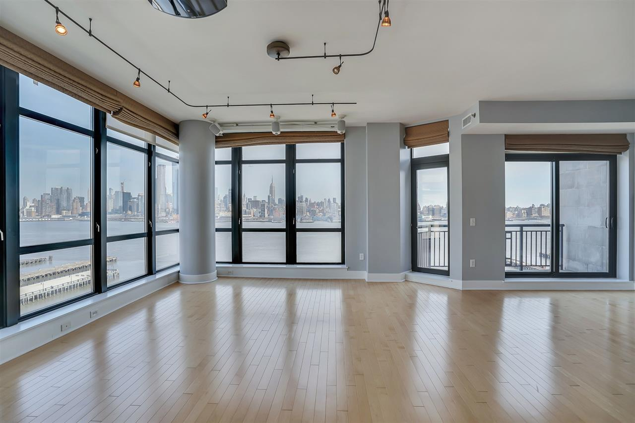 Stunning 2000 sq ft 3 BR 2.5 bath features private terrace with amazing NYC views, 12 ft ceilings, floor to ceiling windows with remote control shades. Gourmet kitchen with custom cabinets, stainless steel appliances & granite counters. Spacious Living room & Dining area, custom walk-in closet, master bath with separate tub and shower, laundry in unit. One garage parking spot for an additional fee. Ferry & shuttle to PATH.