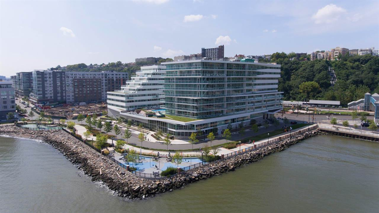 Just steps away from the NY Waterway Ferry Terminal offering a stress-free ride to Midtown Manhattan as well as routes to Pier 11 at Wall St. and World Financial Center. Redefining modern luxury and style, with upscale interior finishes, private balconies and terraces maximizing majestic NYC views. Exceptional amenity package! Avora features a spectacular lobby with 24 hour concierge, grand salon, private screening theater, business center, boardroom, Avora lounge with bar, private dining and catering kitchen, pet spa, and state of the art strength and cardio fitness center. Landscaped outdoor plaza including a pool, spacious sun deck, lounges, grilling areas and fire pits. 184 homes situated in an 11-story building on the Hudson River waterfront with unparalleled views!! One Parking Space included.  *Please note that these photos are not reflective of the listing, but is a model home in the building*