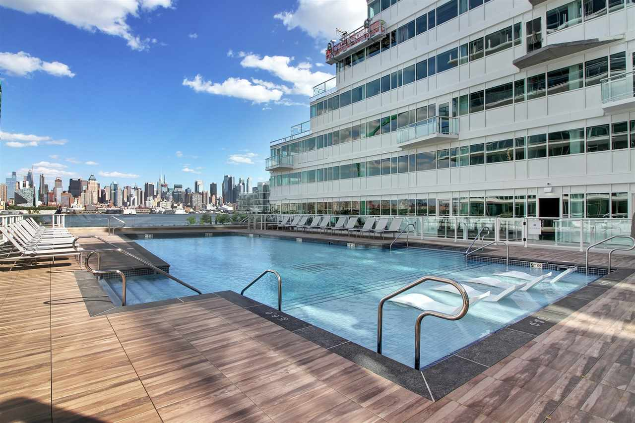 Welcome to Luxury on the Waterfront at Avora. This beautiful home features South Views of NYC. Kitchen Top of the Line Appliances w/ European Cabinetry & Porcelain Counter-Tops. Master Bedroom Suite includes a large Master Bath.Custom closets & window treatments installed. Amenities include 24 hr Concierge, Fitness Center, Theater, Business Center, Grand Salon Lounge w/ Bar & Catering Kitchen, A Outdoor Pool & Sun deck, Grilling areas & a Fire Pit. NY Waterway Ferry & NJ Transit outside your door.Close to shops,restaurants,day care,dog parks, recreational park.
