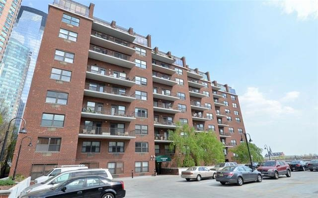 Waterfront 1BR Condo at the edge of the Morris Canal w/ unobstructed view of the NY Skyline. An updated kitchen, with SS appliances, and updated Bathroom, Washer/Dryer, high ceilings, HWF & Walk-In-Closet complete this home. Bldg features 24 Hr Doorman, Valet Parking, Atrium Lobby w/ Glass Elevators, Pool w/ Jacuzzi Tub + Community Rm at penthouse level. Light Rail at corner and NY Ferry 1 blk away. Close to Exchange Place  PATH Station , Restaurants and Shopping.