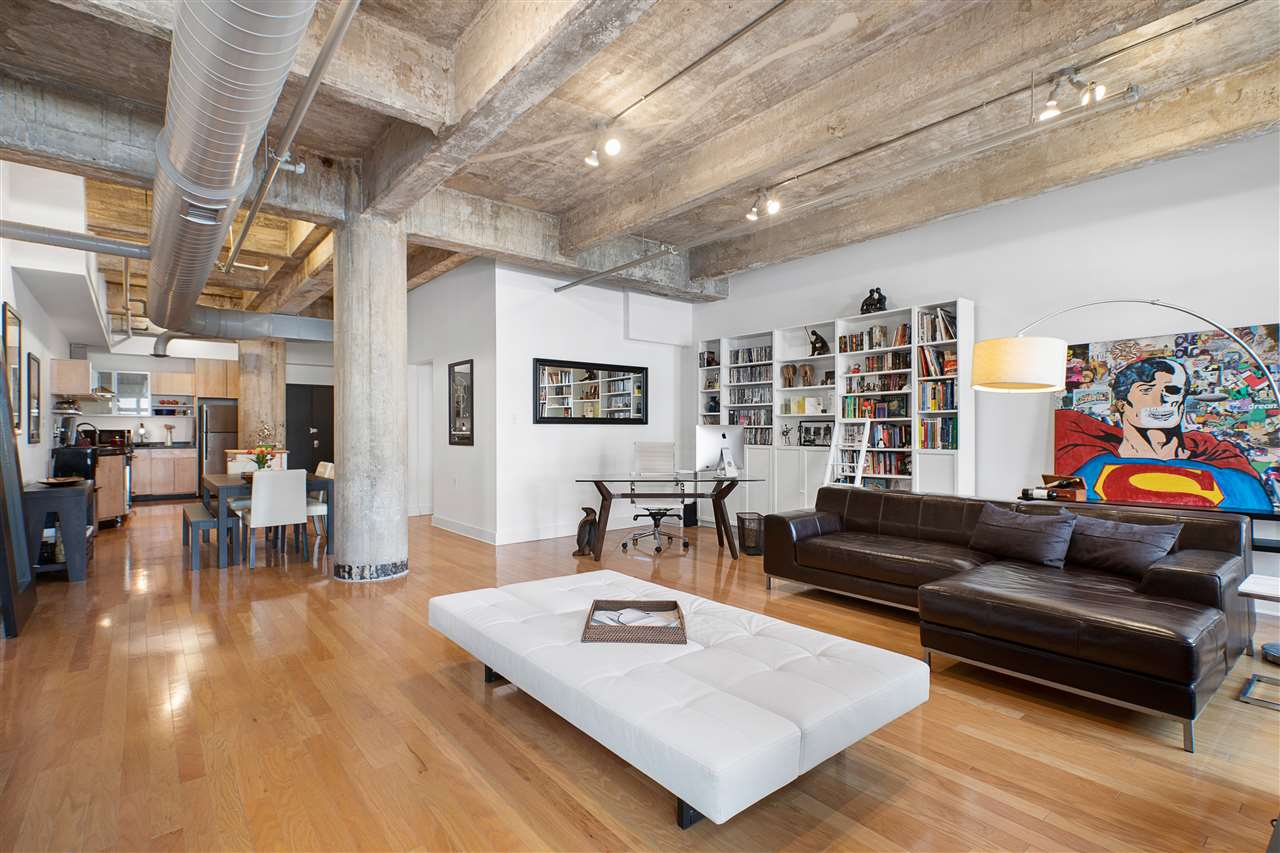 Dynamic Soho style loft space offering 1420 square feet of virtually uninterrupted floor plan for those that like living life outside the ordinary.   The Cooke Loft building is an exemplary building that reaches deep into the history of the Powerhouse Arts District, a former warehouse retrofitted as loft spaces in 2005 offers the most genuine loft living lifestyle in DTJC today.  Loft #5C offers lifestyle living defined by the building's extraordinary dimensions that are grounded in many of the building's original historical details such as the unit's large commercial/industrial styled windows, 11 ft ceilings, impressive unadulterated concrete ceilings and columns, and exposed duct work to give the unit its touch of industrial flair so much a part of the unique chic of modern, urban lifestyles.  The magnificent open space of this super-sized one bedroom and 1.5 baths floor plan features a long and dramatic, generous kitchen and dining area upon entering that flows graciously into a grand living area that offers a glorious 22x22 open space to fashion to your vision.  Create in it, work and live in it, fashion it to your own design, or restructure it to easily add a second bedroom to the floor plan if desired.  The unit's existing bedroom is striking in its 19x13 dimension easily accommodating a king sized bed and second sitting/parlor area for the unit.  Upgraded full bath adjoins unit comfortably.  This remarkable space also offers central air and heating, wood floors throughout, full sized stacked washer/dryer in unit, and large closets.  The Cooke Lofts is one of downtown Jersey City's most notably singular boutique style buildings featuring a large entry lobby reminiscent of its history, and boasts a large common roof deck for outdoor lounging.  The Powerhouse Arts District is DTJC's most vibrantly moving district,  located at the doorstep of the Grove Street PATH station for an easy and expeditious commute to NYC, along with easy pedestrian access to the growing