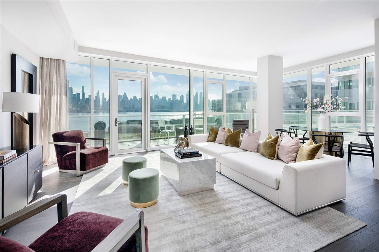 INCREDIBLE 2 bedroom+Den/2 bath at Port Imperial's newest and most sophisticated residential collection, The Avora.   Residence features include nearly 1,600 sq/ft of living space, separate den, and spectacular views of Manhattan!  UNIT HIGHLIGHTS: * Approximately 1,600sf * 2 Bedrooms + Den * 2 Bathrooms * Stunning southern views * Open, Chef's Island Kitchens With Kitchenaid™ Professional Grade Stainless Steel Appliances * Designer Spa Bathroom – Including Italian Porcelain Tile, Freestanding Bathtub, and Robern™ Medicine Cabinets & * Integrated Lighting  * Beautiful Windows Throughout the Residence  * In-Unit Washer and Dryer* * 5-inch Wide Plank Hardwood Flooring * Pre-Wired for Motorized Shades and Window Treatments * Private Parking Space Included!  BUILDING AMENITIES: * 24-Hour Lobby with Concierge Service * Pool Deck with BBQ Grilling Stations, Cabanas, and Lounge Areas * State-Of-The-Art Strength and Cardio Fitness Center with Spa Equipped Sauna and Steam Rooms * Indoor Driving Range  * Private Club Room with Bar and Catering Kitchen * Private Screening Theater * Children's Play Room * Bike and Stroller Storage  * On-Site Pet Grooming Facilities * Secure Parking Garage * Steps from NY Waterways Ferry Terminal (8 Minute Ride to Midtown), The Port Imperial Light Rail & The Waterfront Promenade * Access to the NJ Transit Bus System, NY Waterways Ferry, NJ Transit Path Train, and Minutes Away from The Lincoln Tunnel, Holland Tunnel, and George Washington Bridge.   The Avora at Port Imperial offers world class amenities, luxury finishes, and breathtaking views of the Hudson River and Manhattan Skyline. Designed by the world-renown IBI Group, The Avora offers residents a stunning full service lobby with concierge and coffee bar, Avora lounge with bar and catering kitchen, private screening room, golf simulator, on-site pet grooming, and state of the art fitness center!   (please note photos provided are stock photos of a model residence, actual unit photos coming soon)  © 2018 Landsea Homes. Plans, pricing, product information, square footage, amenities and community/building information are subject to change without notice or obligation. Photographs, renderings, furnishings, and floor plans are for representational purposes only and may not reflect the exact features or dimensions of your home. Some features and options shown may not be offered in your community/building. Please see the actual purchase agreement for additional information, disclosures and disclaimers relating to your home and its features. All rights reserved and strictly enforced. The materials and finishes in the Condominium are described in the public offering statement and are subject to modification as provided in the public offering statement. All dimensions are approximate and subject to normal construction variances and tolerances. Sponsor makes no representations or warranties with respect to the Units or the Building, except as may be set forth in the public offering statement. The complete offering terms are in an offering plan available from Sponsor. File R-4774. Obtain a copy of the State of New York CPS-12 application and exhibits prior to purchase File No. CP16-008.