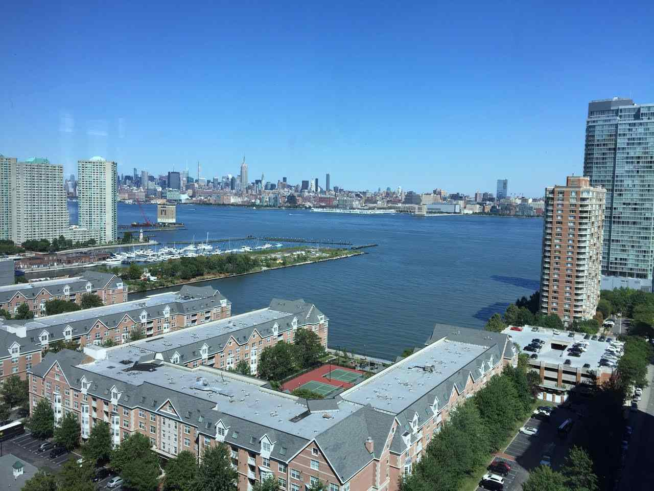 "Very high floor luxurious ""A Condo"" unit with floor to ceiling glass windows and breathtaking views of midtown to downtown Manhattan and the river.The largest condo available at 1366 square feet and one deeded parking space included in the sale.Maintenance  includes heat,hot water,gas,gymnasium,outdoor huge  patio,lounge area and kids playroom.Nestled in the PS 16 schooling district and walking distance to path station.One deeded parking spot included."