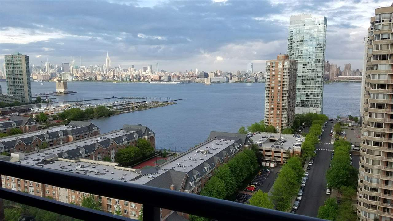 "High floor one bedroom condo available at the luxurious ""A Condos"" with breathtaking views of midtown,downtown n the river.The maintenance includes heat,hot water and gas,gymnasium,lounge,kids play area,huge outdoor patio etc.Parking is easily available to rent in the building.Nestled in the PS 16 school district and walking distance to path station for easy access to the city.Close to other malls and highways as well."