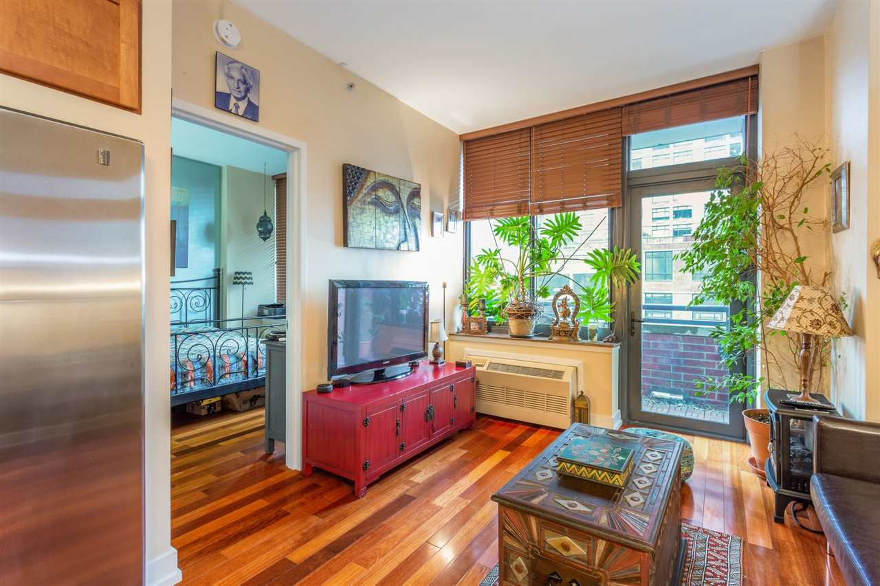 Welcome to the A Building! This spacious 1-bedroom has all of the modern amenities of luxury living. A well-appointed kitchen with center island leads out to your sun-filled living room. Gleaming hardwood floors throughout. Step out to your private balcony with views of the Downtown Jersey City landscape. Enter your large bedroom with plenty of closet space. In-home washer/dryer. Building amenities include a 24-hour concierge, sun deck with BBQ, well appointed lounge, fitness center, and playroom. At A Building, you're in the heart of it all. Easy commute into the city, close proximity to restaurants, shopping, waterfront, multiple PATH stations, light rail, and ferry. Rent includes 1 garaged assigned parking space, building amenities, heat, hot water, and gas (electric not included). Available 1st week of July. Call for your private showing today.