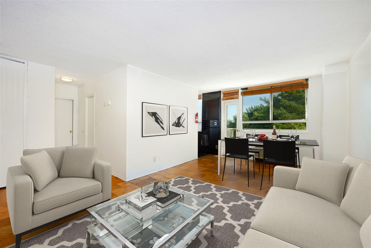Visit this 1 bedroom, 1 bath with NYC Freedom Tower views, private balcony and open bright living space. This line offers one of the largest 1 bedroom living room areas. Kitchen includes modern cabinetry, granite counter tops,  dishwasher, refrigerator. Bathroom features modern tile work and walk in shower in floating glass enclosure.  Combined with brilliant views, this full-service building includes terrific amenities and a coveted location, just minutes to NYC via transportation or a few blocks to Hoboken. Benefit from 24-hour concierge service, outdoor pool, residents lounge, gym, dry cleaner, deli and reasonably priced on-site parking. Storage available for fee. Shuttle to Hoboken PATH. Maintenance Includes: Taxes, Electric, AC, Heat, Hot/Cold Water. (pic virtually staged with furniture)