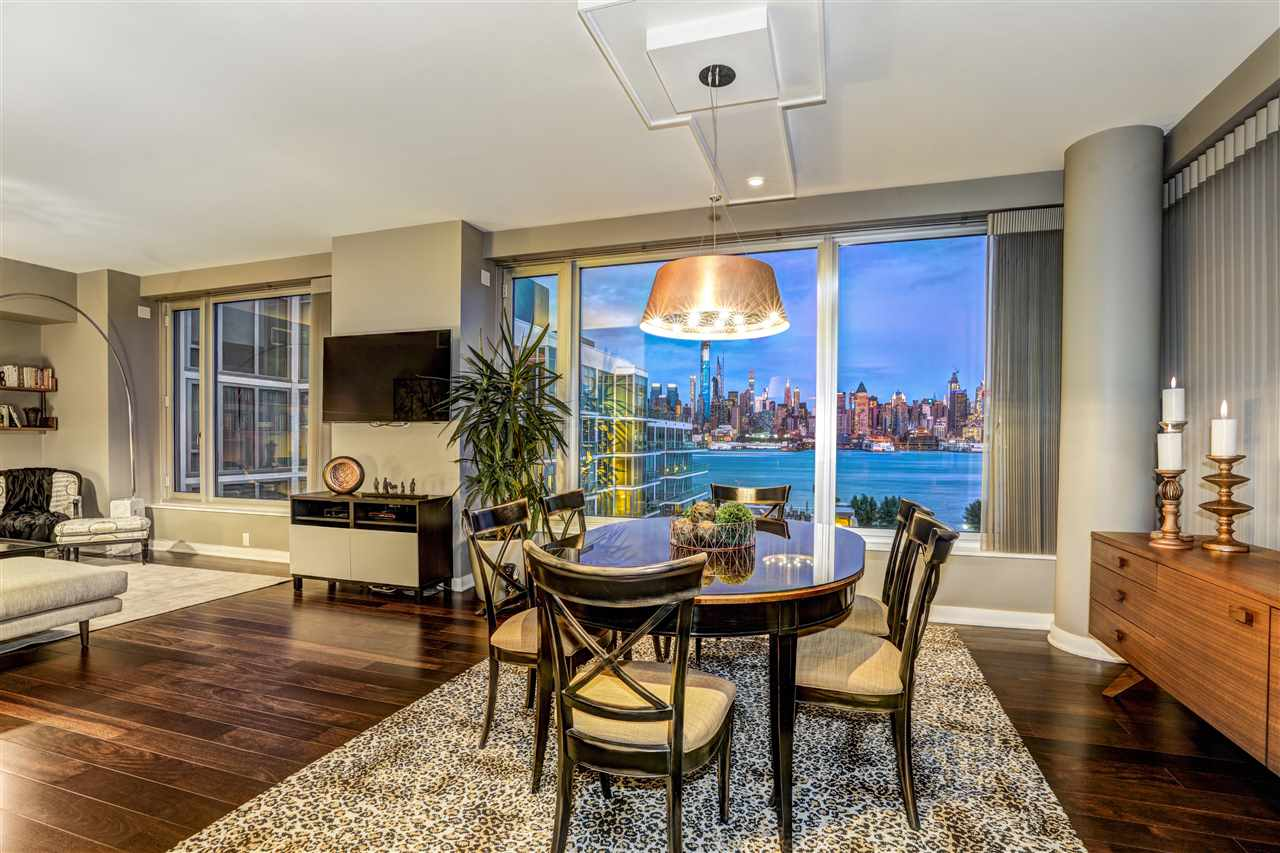 A beautiful home with strong features but a calm feel, 601 is a coveted, top floor corner unit in a premier, waterfront community. With views from every room, a pathway of green outdoor space and sparkling water leads your eyes from inside wide windows toward Manhattan's iconic skyline. The 1,700+ square foot floor plan offers the ability to easily add a 3rd bedroom or an office. Your master suite was enlarged by borrowing from the long hallway. California Closets were added here and everywhere. Both bathrooms and the kitchen are finely finished. Your personal parking spot fits 2 large vehicles. Access to the New York Waterway, New Jersey Light Rail and Bus is steps away, making your commute quite simple.   An affluent neighborhood on Weehawken's wonderful waterfront, The Avenue Collection's happy homeowners love their concierge, challenge themselves in the gym, lounge by the pool, play on the grass, and savor the sunsets over the Greatest City in the World.