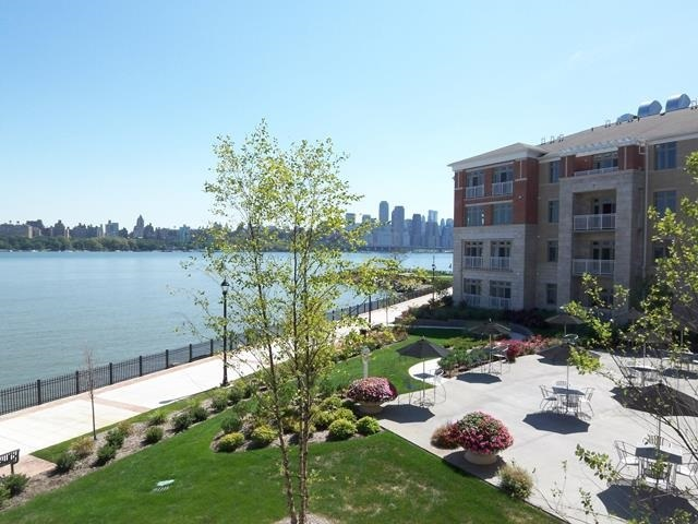 PENTHOUSE LEVEL!! Welcome  to this premier waterfront building located at Hudson Pointe. Positioned Direct EAST NYC and Hudson River views, this 2 Bed/2 Bath condo stretches across approx 1,223 SqFt. This open living layout includes stainless steel appliances and granite counter tops which overlooks the living room with a walk-out balcony that features unobstructed NYC views. An amazing master suite has a huge walk-in closet and modern master bath. Second bedroom is very spacious and also has river views. Bonus W/D in apartment. One of the nicest pool on the river and gym and easy access to all community amenities. Amenities include 24hr doorman, fitness center, business center, cinema room and a pool. Special convenience of two car indoor parking which is RARE! Easy access to NYC with NJTransit and Ferry Shuttle Bus located right across the street. OPEN HOUSE SUNDAY 10-27 1-3pm