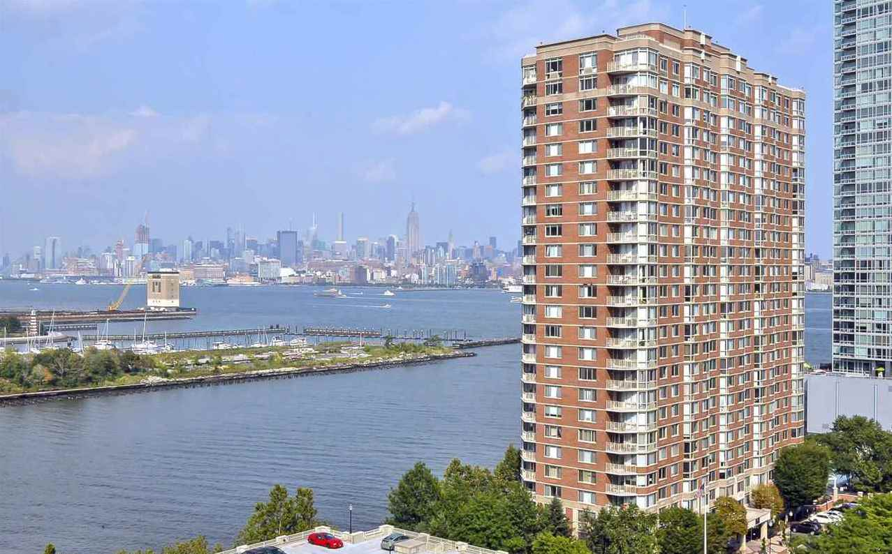 This furnished one bedroom apartment at the wildly popular Mandalay on the Hudson features spectacular New York Skyline and Hudson River views. The upgraded kitchen features granite counter tops and stainless steel appliances. The in-unit washer/dryer adds convenience, as does a secure parking space on the parking deck. Enjoy 24 hour concierge, the largest swimming pool in Downtown Jersey City -- and amenities including community room, patio with BBQ grills, well-equipped gym, and tot-lot.  Conveniently situated near Newport and Exchange Place PATH stations, shopping and restaurants.