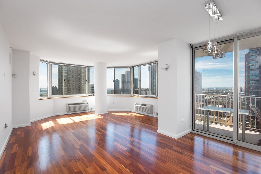 LANDLORD OFFERING $2100 off of the first month's rent! That's more than 1/2 month free! Base rent is $3975, with $2100 amortized over 12 months = $3800 net effective rent. Bright, Beautiful south facing, corner home on the 24th floor with gorgeous River views and private terrace! This freshly painted, large 2 bedroom 2 bath unit has a spacious layout, gleaming wood flooring, large master bedroom, two large baths, brand new washer/dryer in unit and a gleaming, modern kitchen with top of the line appliances, radiant heat in the floor and a window. Endless amenities include pool, kids playground, fitness room, residents lounge, and full service concierge. Close to all modes of transportation PATH, Light Rail and Ferry. Complementary shuttle to Newport during winter months. Indoor garage parking available! The space is a premium spot on 2nd floor with easy access into building! Cable and Internet included in rent! 1 Month broker fee. LANDLORD OFFERING $2100 off of the first month's rent! That's more than 1/2 month free! Base rent is $3975, with $2100 amortized over 12 months = $3800 net effective rent.