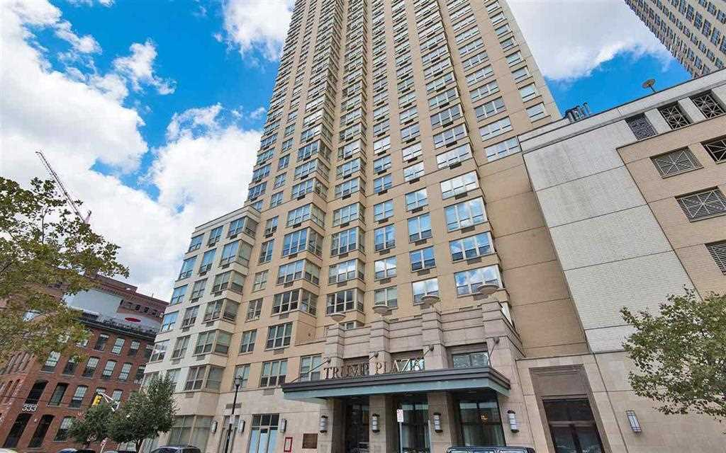Gorgeous 1 bedroom at the Trump Plaza Residences in Downtown Jersey City. This high floor western facing home features hardwood flooring throughout, cherry kitchen cabinets with granite counter tops & breakfast bar, stainless steel appliances and high-end finishes. Your expectations will be surpassed in this awesome luxury residence: 24 hour full service doorman, Trump Concierge, heated rooftop swimming pool, 8,000sq.ft fitness center w/personal trainers available, Private landscaped yard, Virtual golf, Home Theater Screening Room, Billiards room, Business conference center, Private garage valet parking available, On-site Zip Cars for rent, Dry cleaning and laundry service, 5 star full service spa. A quick stroll to the Path, shops, parks, and restaurants.