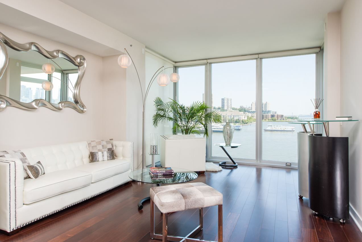 Incredible 2 bedroom 2 bathroom with unobstructed breath-taking views of both the NYC Skyline and Hudson River on the Weehawken waterfront! Live in luxury at the prestigious Avenue Collection with state of the art amenities featuring a 24- hour doorman; concierge services, guest suites, onsite conference room, outdoor pool with city views, sun deck terrace with fire pit, open lawn and lounge areas, health club & fitness center, sauna, yoga room, on site storage, club room with a beautiful lobby, fireplace, and a catering kitchen with a bar area. In unit features include; floor to ceiling windows in all rooms, automatic blinds system installed, granite countertops, state of the art GE Monogram appliances, private balcony/terrace with unobstructed waterfront views, custom cabinetry, and luxurious hardwood floors. Dedicated covered parking space also included. Located just a moment's walking distance to the NY Waterway at Port Imperial, with a quick 10 minute commute to midtown Manhattan! Additional commuter options include Light Rail/Path or NJ Transit. Make your appointment to tour your beautiful new dream home today!